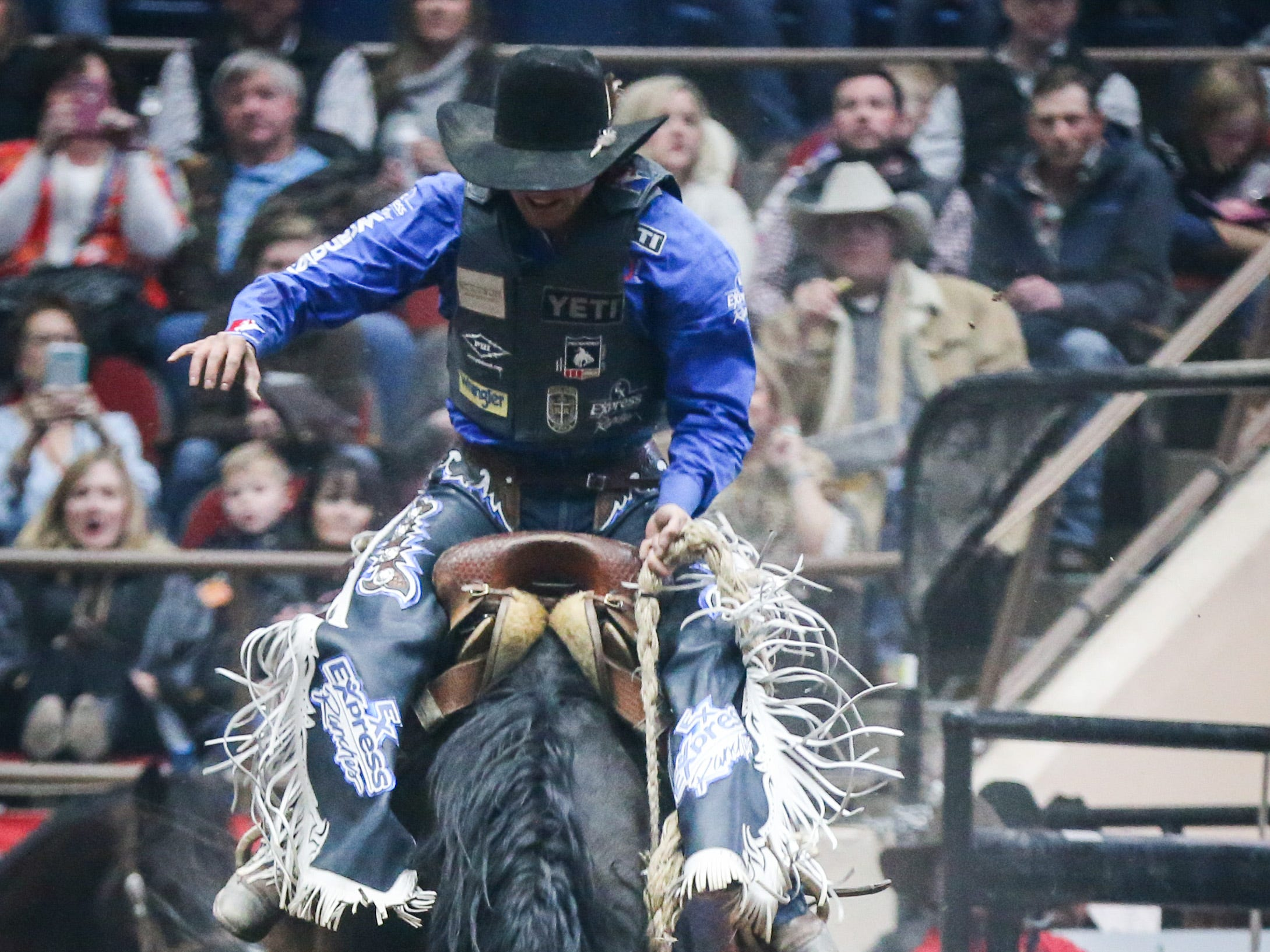 Rusty Wright rides Banshee during the San Angelo Stock Show & Rodeo show Saturday, Feb. 9, 2019, at Foster Communications Coliseum.