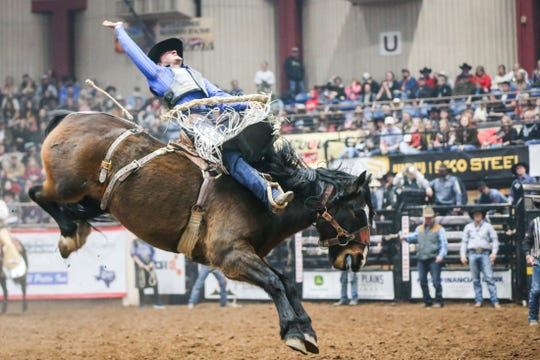 Rusty Wright rides Banshee during the San Angelo Stock Show & Rodeo show Saturday, Feb. 9, 2019, at Foster Communications Coliseum. He scored 87.5 on his ride.
