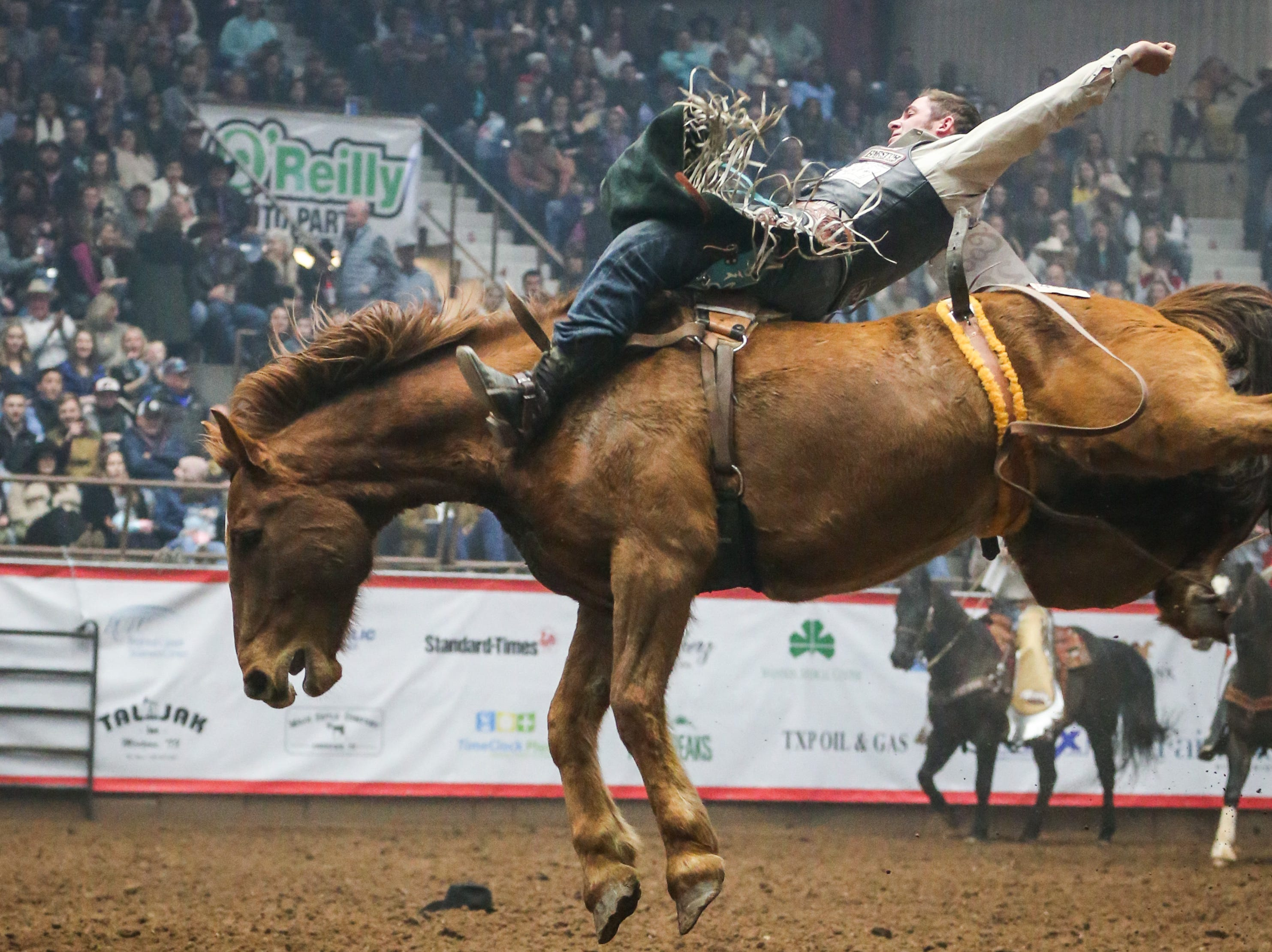 Austin Foss rides bareback during the San Angelo Stock Show & Rodeo show Saturday, Feb. 9, 2019, at Foster Communications Coliseum. He had an 85 point ride.