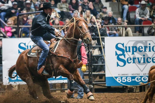 Trevor Brazile throws his rope to catch a calf in tie down roping during the San Angelo Stock Show & Rodeo show Saturday, Feb. 9, 2019, at Foster Communications Coliseum.