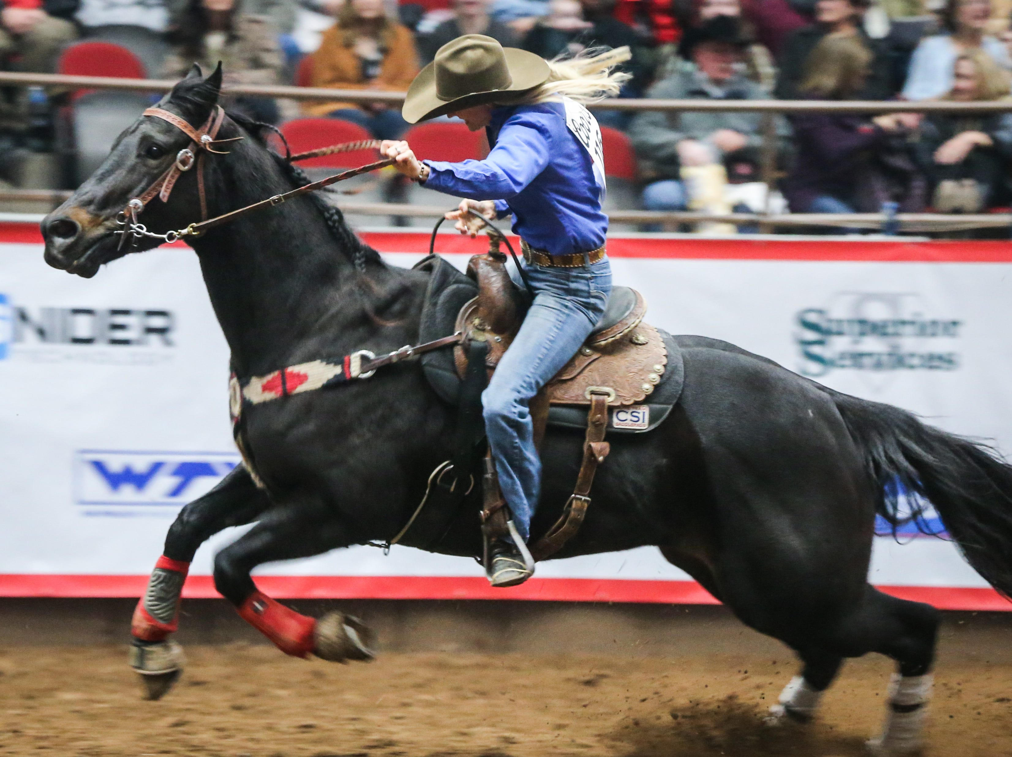 Nicole Laurence races back across the arena during the San Angelo Stock Show & Rodeo show Saturday, Feb. 9, 2019, at Foster Communications Coliseum.