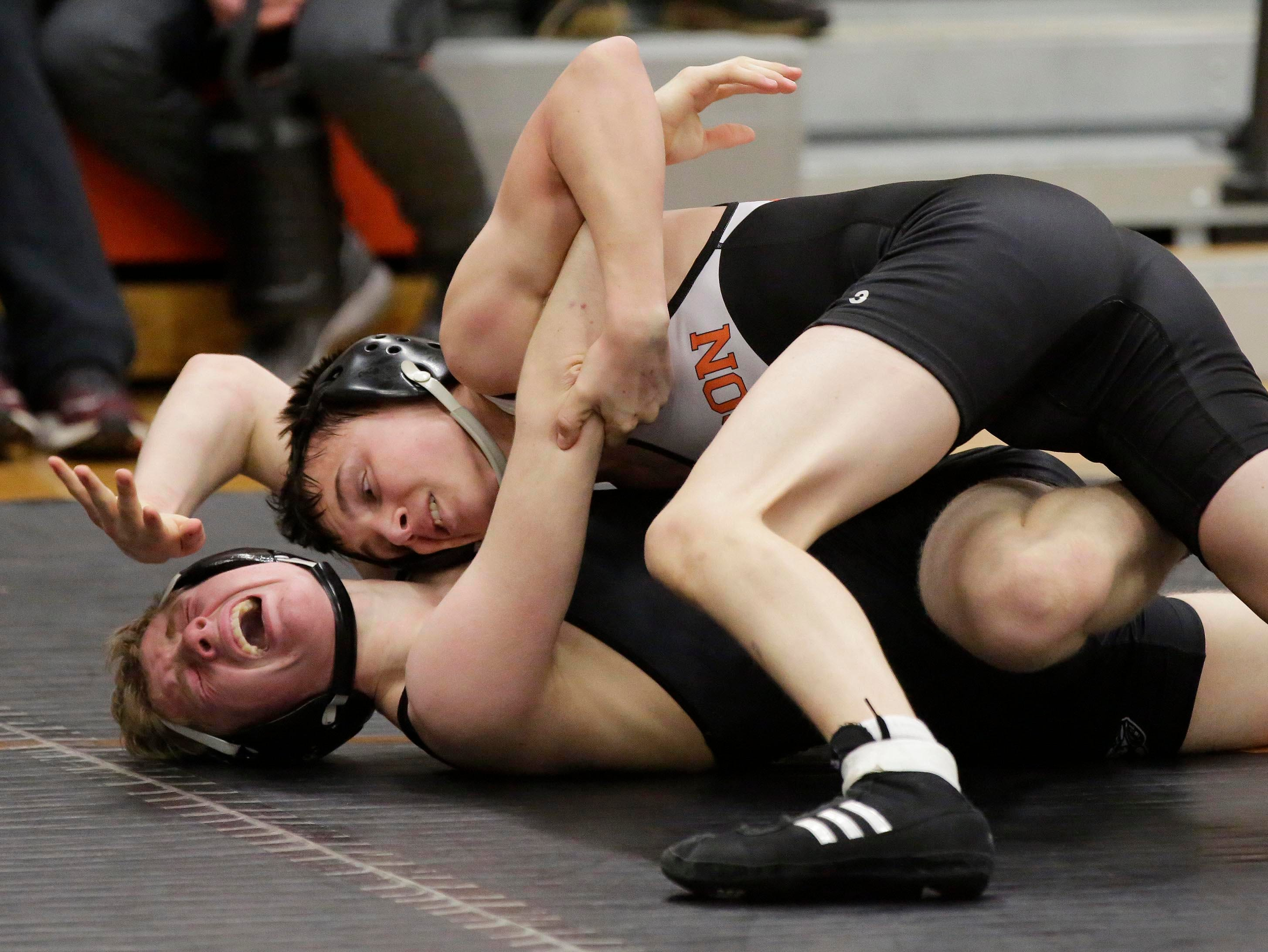 Horicon's Chance Tuttle, top, puts the squeeze on Random Lake's Dylan Weiss in a 120-pound bout at the WIAA Div. 3 Wrestling Regional, Saturday, February 9, 2019, in Oakfield, Wis. 