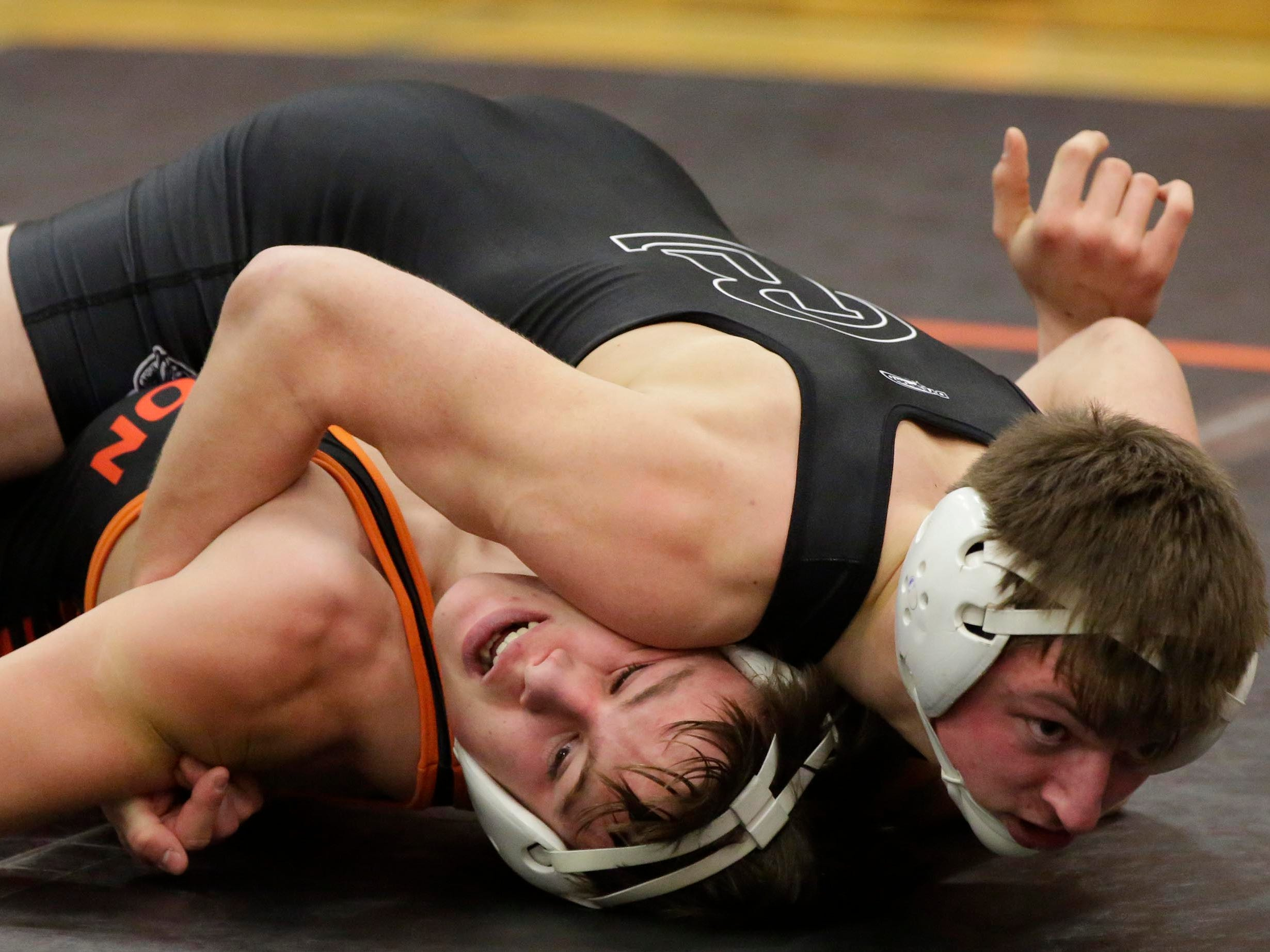 Random Lake's Joey Bock, right, wrestles Horicon's Marshall Coffey, bottom, in a 145-pound match at the WIAA Div. 3 Wrestling Regional, Saturday, February 9, 2019, in Oakfield, Wis. 