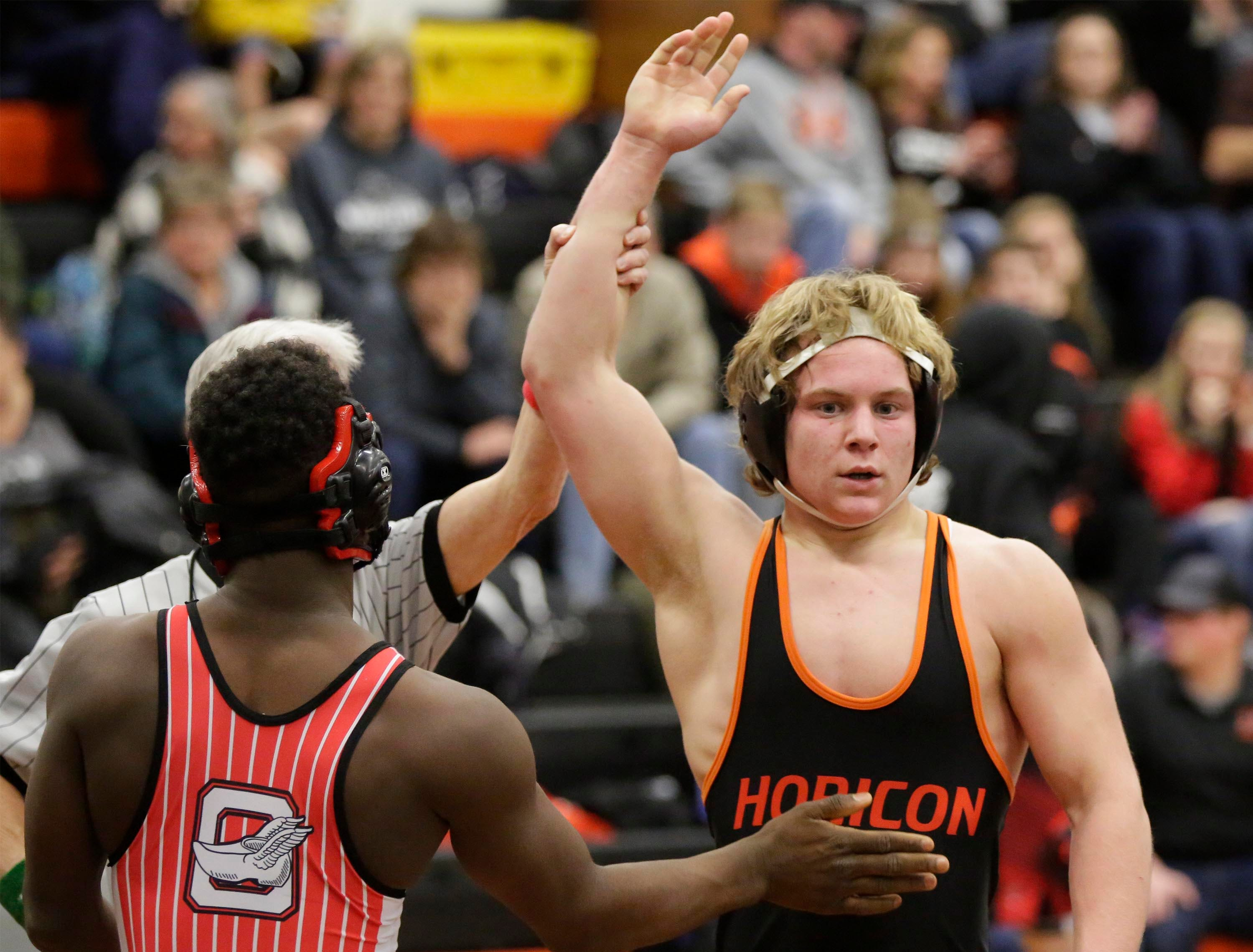 Horicon's Josh Thomsen arm is raised in victory, right, after he defeated Oostburg's Jay DeBlaey in a 152-pound bouth at the WIAA Div. 3 Wrestling Regional, Saturday, February 9, 2019, in Oakfield, Wis. 