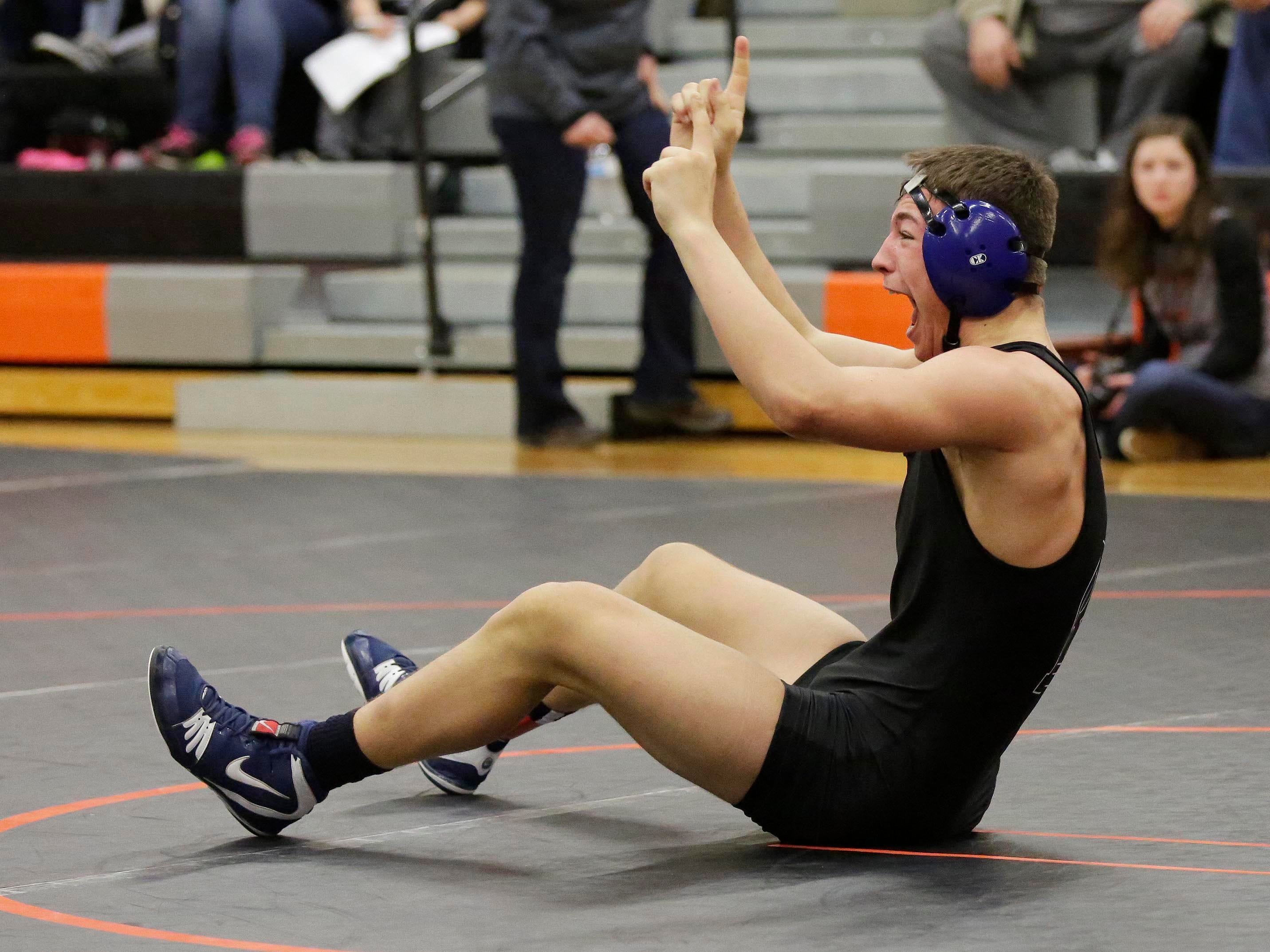Random Lake's Sam Schwabe points skyward following his win over Cedar Grove-Belgium's Sawyer DeRuyter in a 170-pound match at the WIAA Div. 3 Wrestling Regional, Saturday, February 9, 2019, in Oakfield, Wis. 