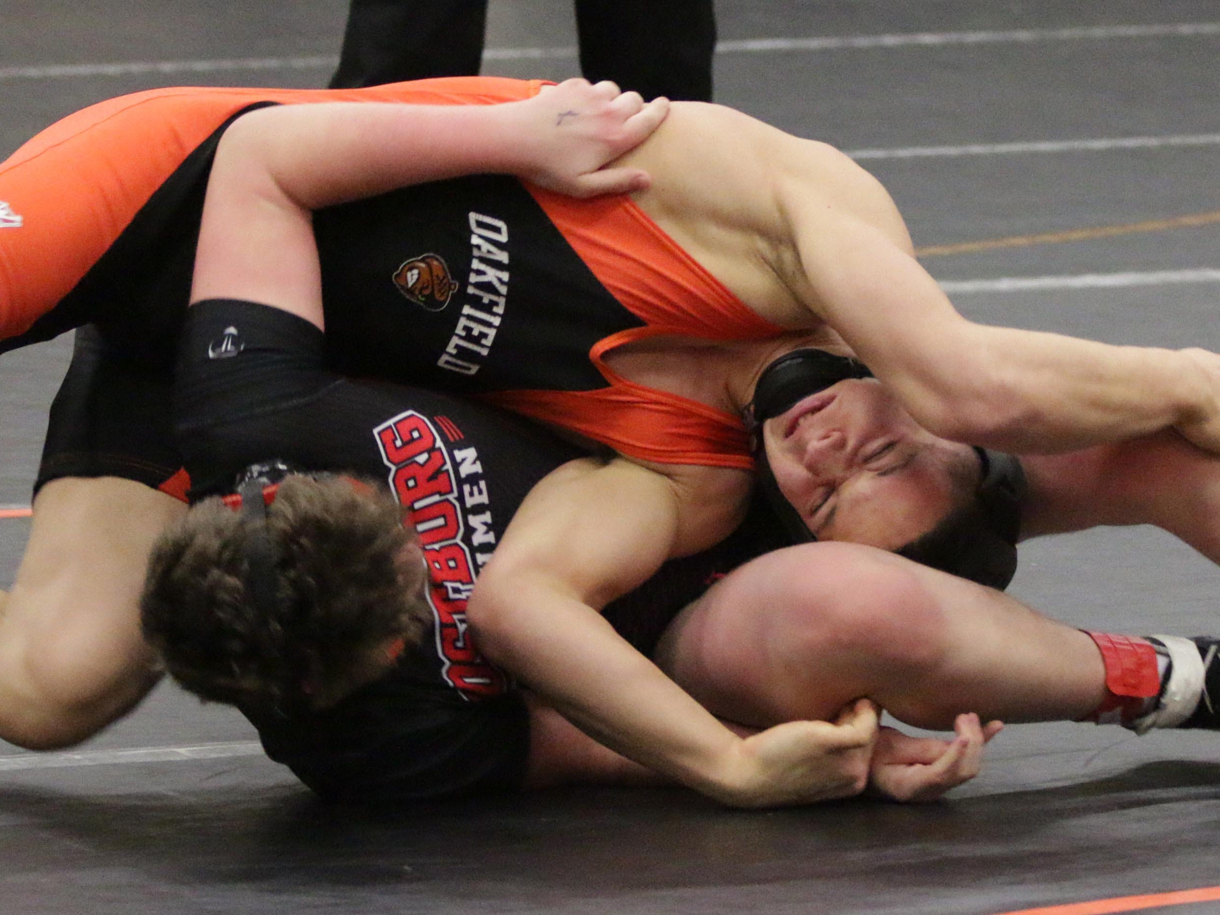 Oakfield's Brendan Hartwig, top, wrestles Oostburg's Mason Heinz in a 170-pound match at the WIAA Div. 3 Wrestling Regional, Saturday, February 9, 2019, in Oakfield, Wis. 