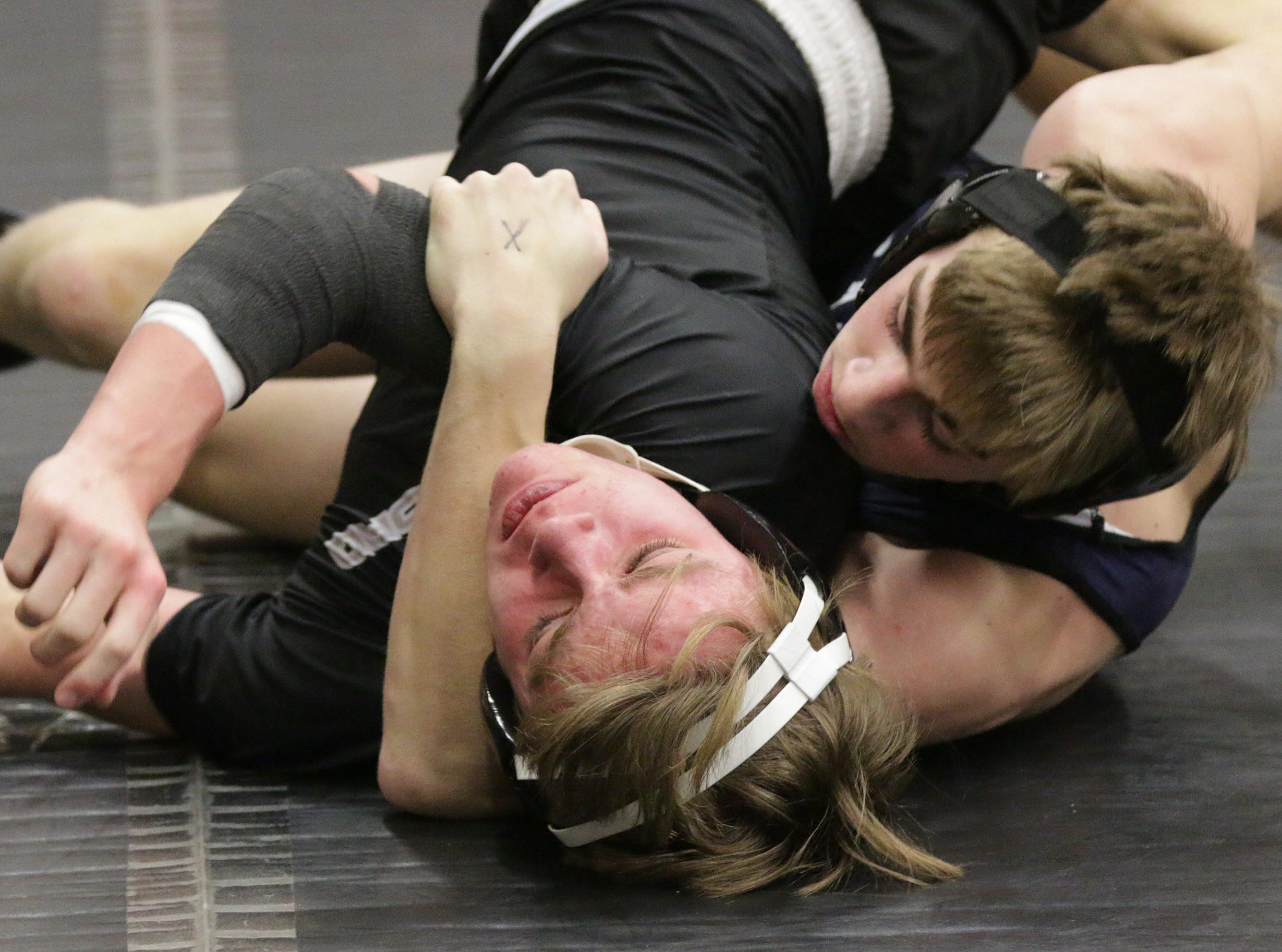 Living Word Lutheran's Roland Guknecht, left, wrestles Random Lake's Hayden Scholler in a 138-pound bout at the WIAA Div. 3 Wrestling Regional, Saturday, February 9, 2019, in Oakfield, Wis. 