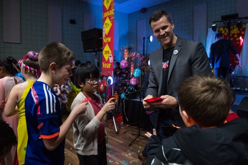 Mayor Paul TenHaken hands out red envelopes to kids at the Lunar New Year Festival in Sioux Falls, S.D., Saturday, Feb. 9, 2019.