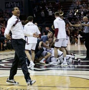 Missouri State coach Dana Ford celebrates as the Bears win against the Illinois State Redbirds at JQH Arena in Springfield on Feb. 10, 2019.
