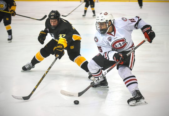 St. Cloud State's Micah Miller drives against Ben Israel of Colorado College during the first period of the Saturday, Feb. 9, game at the Herb Brooks National Hockey Center in St. Cloud.