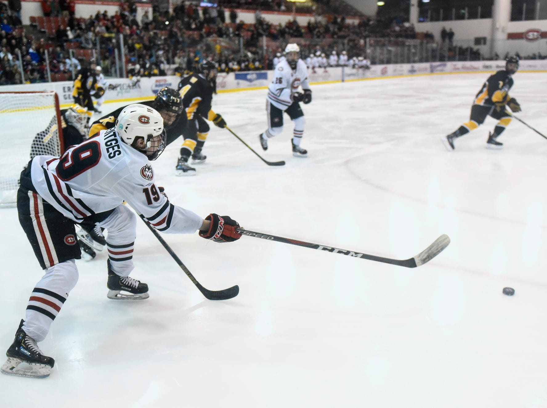 Sam Hentges passes the puck to an open teammate during the first period of the Saturday, Feb. 9, game at the Herb Brooks National Hockey Center in St. Cloud.