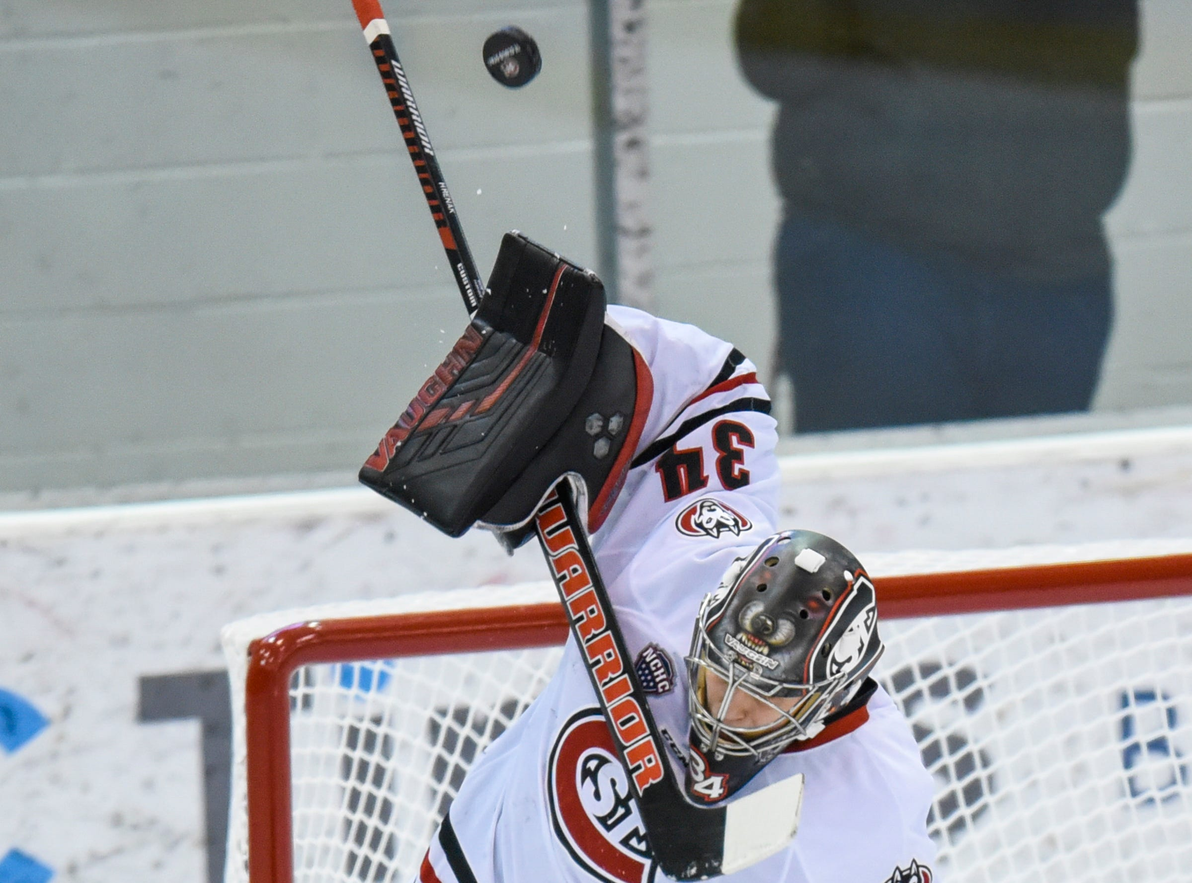 St. Cloud State goaltender David Hrenak makes a save during the first period of the Saturday, Feb. 9, game at the Herb Brooks National Hockey Center in St. Cloud.