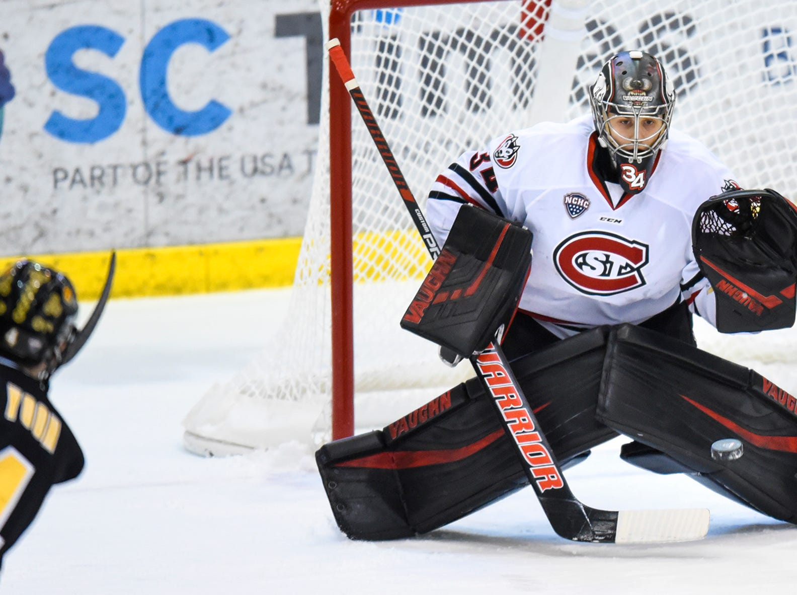 St. Cloud State goaltender David Hrenak concentrates on the puck during the first period of the Saturday, Feb. 9, game at the Herb Brooks National Hockey Center in St. Cloud.