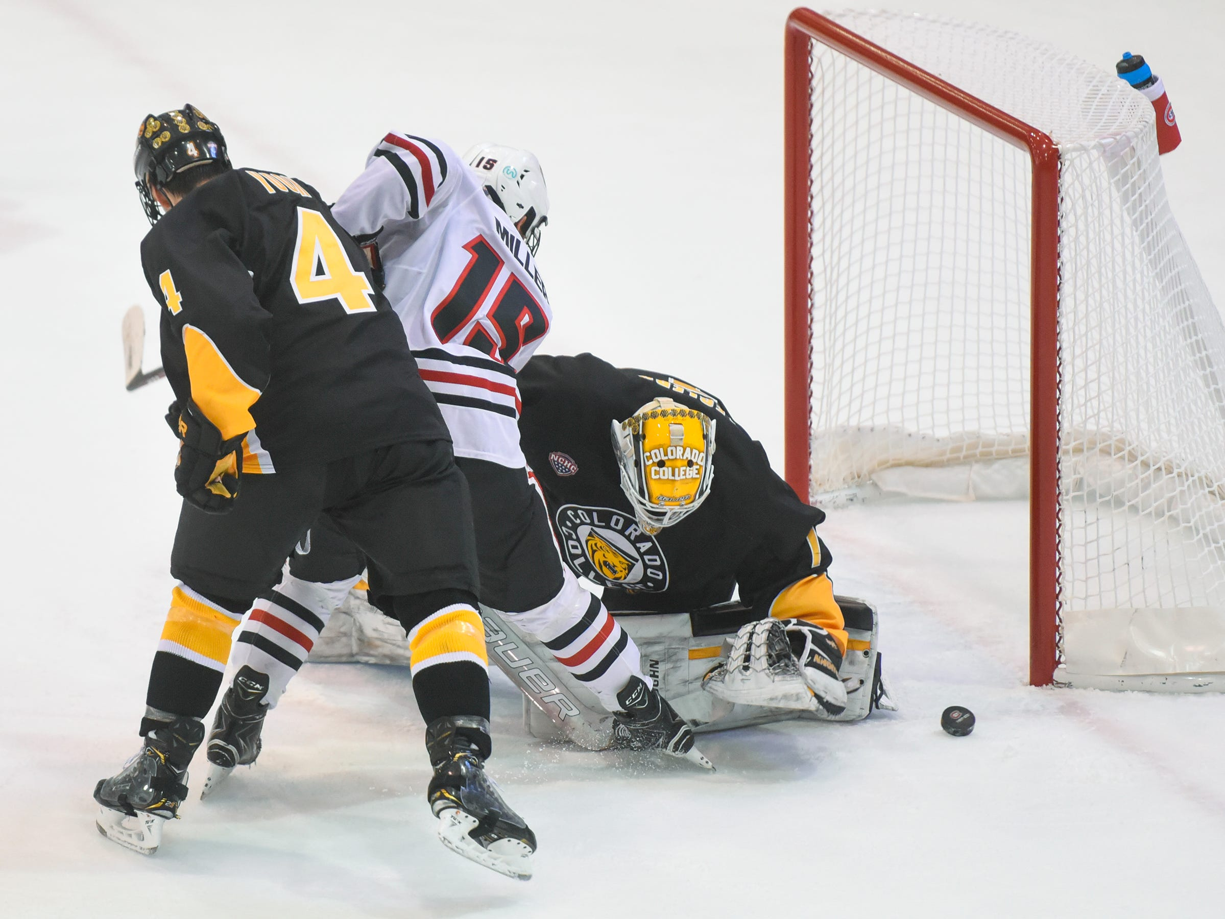 A shot by St. Cloud State's Micah Miller skips past Colorado College goaltender Alex Leclerc during the first period of the Saturday, Feb. 9, game at the Herb Brooks National Hockey Center in St. Cloud.