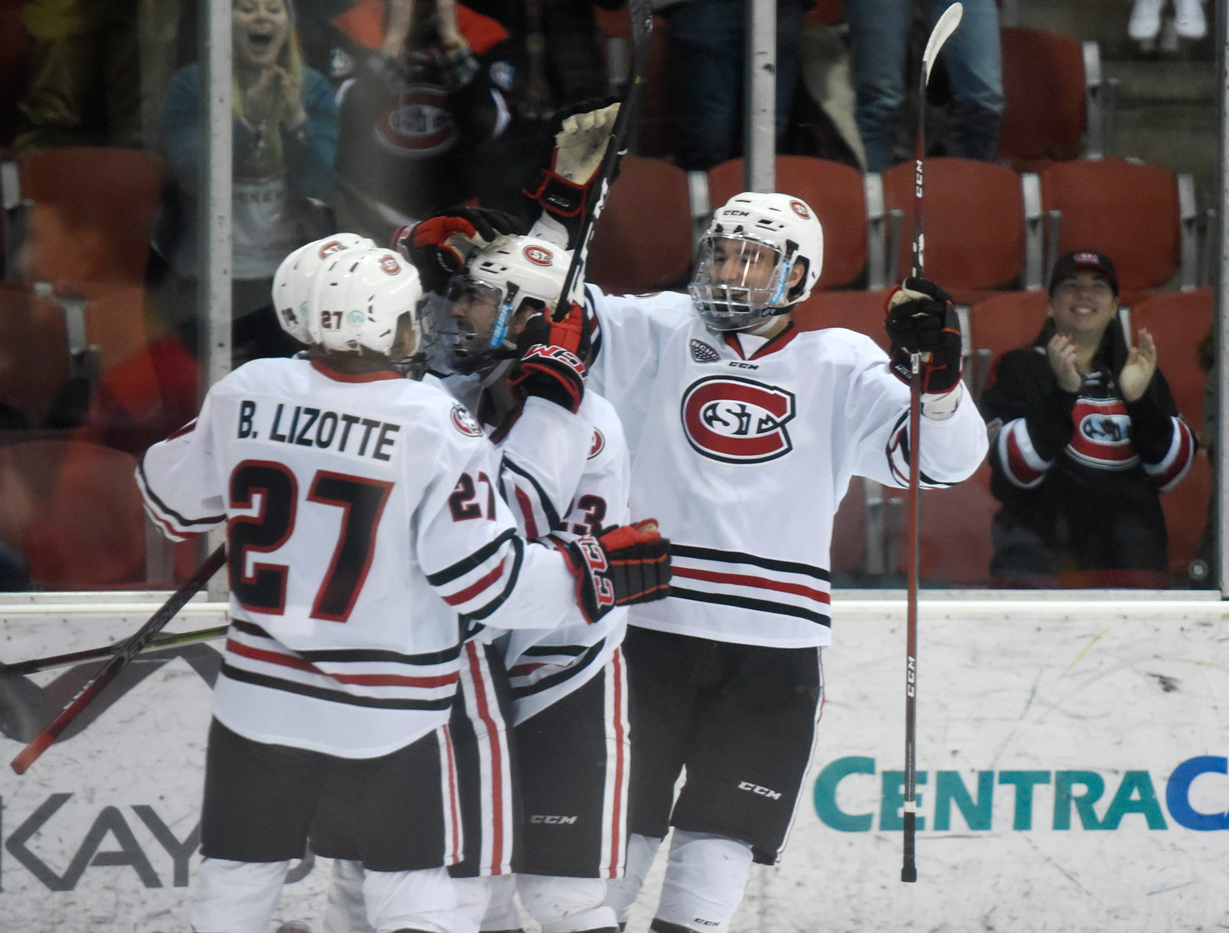 St. Cloud state players celebrate a goal during the first period of the Saturday, Feb. 9, game at the Herb Brooks National Hockey Center in St. Cloud.