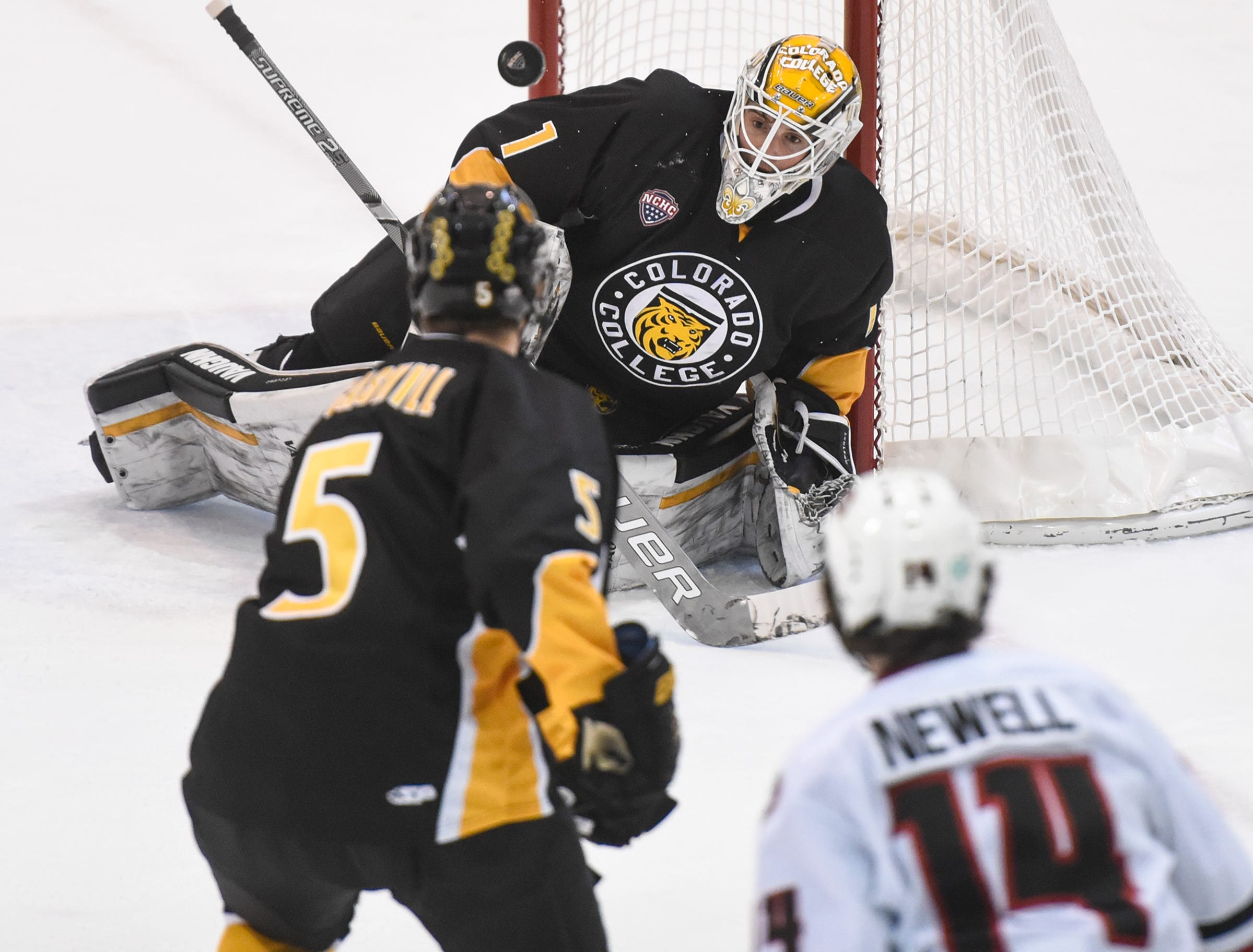 The puck bounces high over Colorado College goaltender Alex Leclerc during the first period of the Saturday, Feb. 9, game at the Herb Brooks National Hockey Center in St. Cloud.