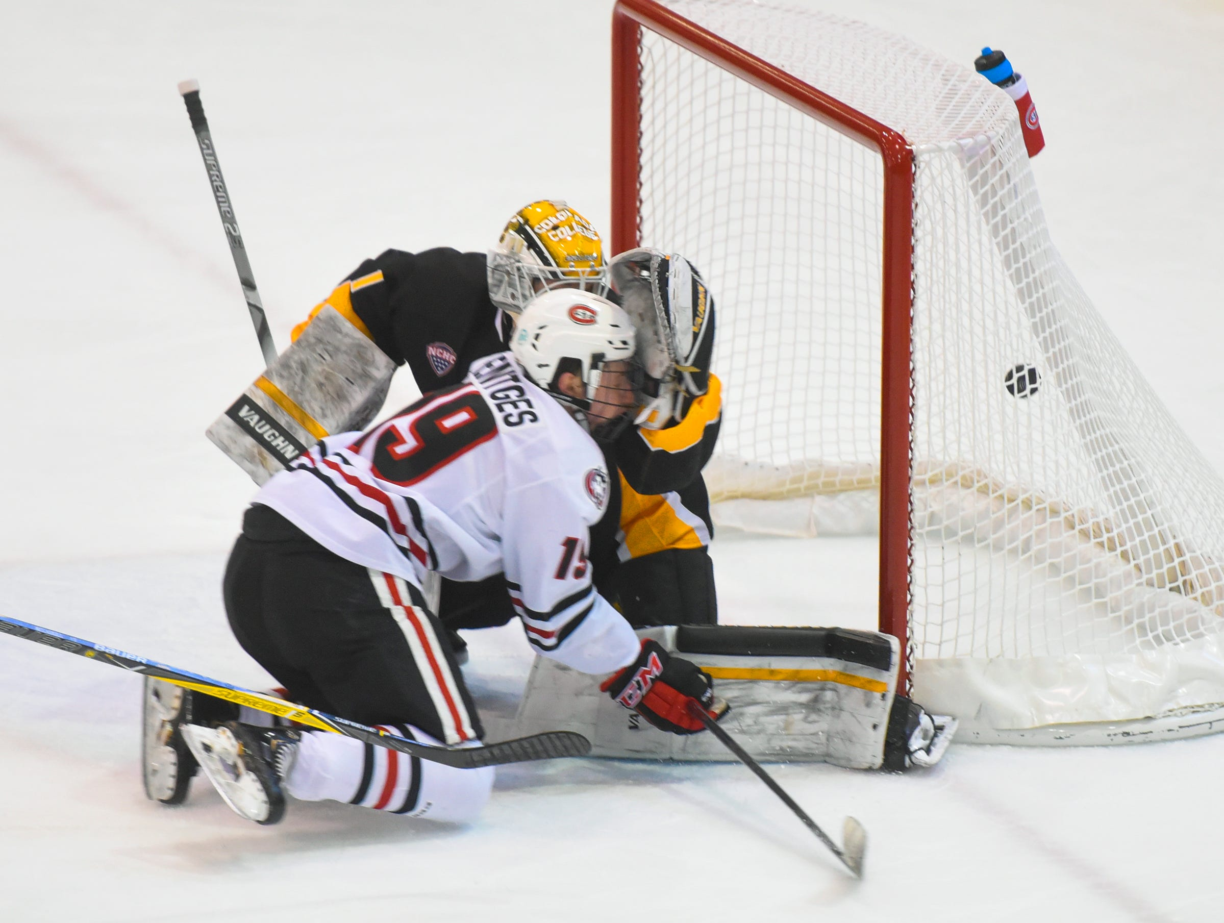 St. Cloud State's Sam Hentges slides into Colorado College goaltender Alex Leclerc after scoring a goal during the first period of the Saturday, Feb. 9, game at the Herb Brooks National Hockey Center in St. Cloud.