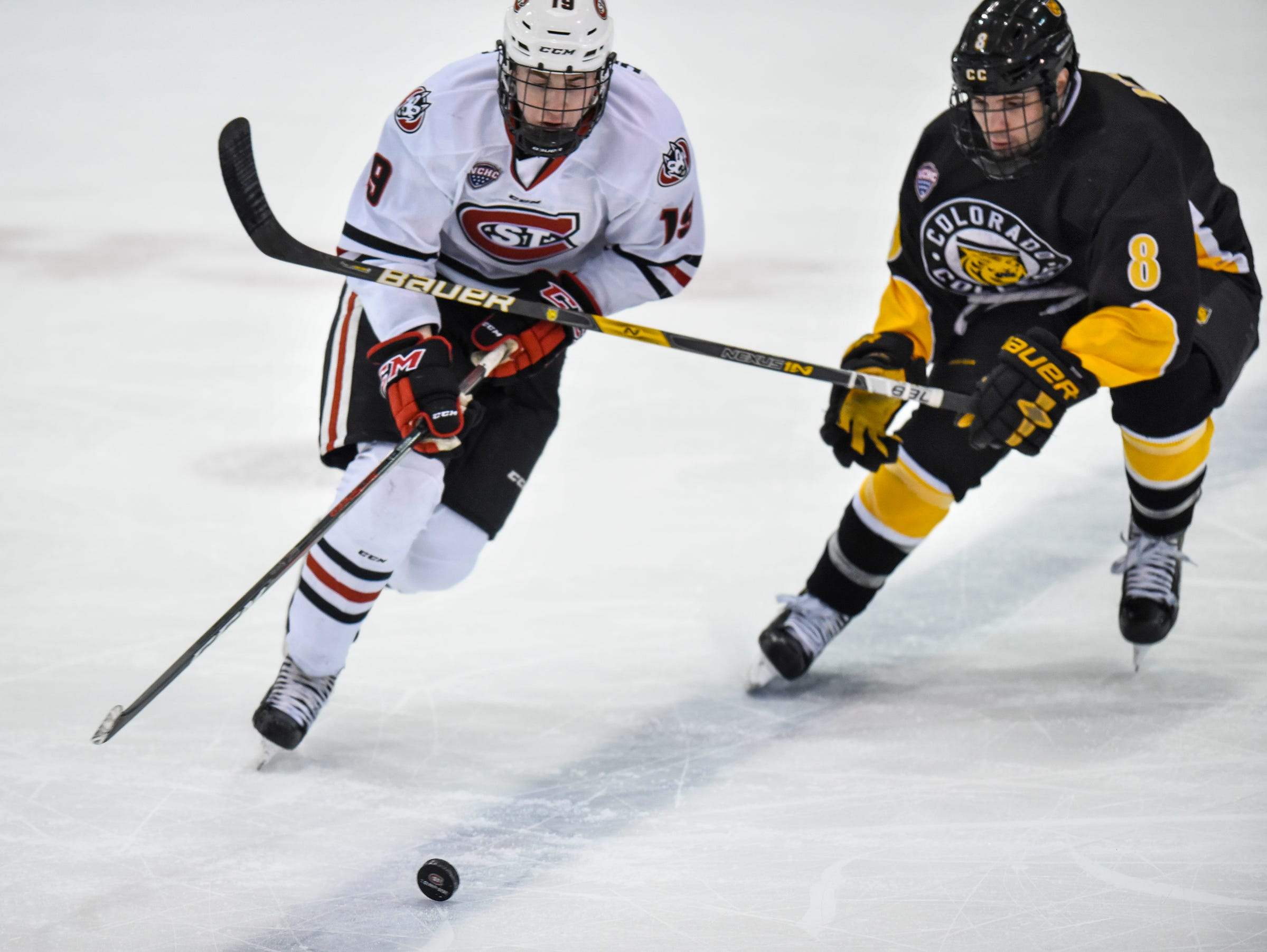 St. Cloud State's Sam Hentges tries to get past Zach Berzolla of Colorado College during the first period of the Saturday, Feb. 9, game at the Herb Brooks National Hockey Center in St. Cloud.
