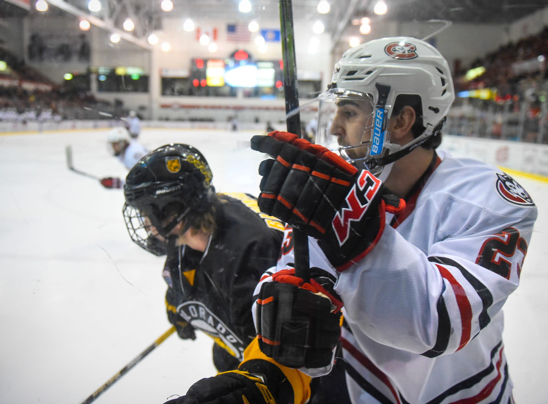 St. Cloud State's Robby Jackson works along the boards during the first period of the Saturday, Feb. 9, game at the Herb Brooks National Hockey Center in St. Cloud.