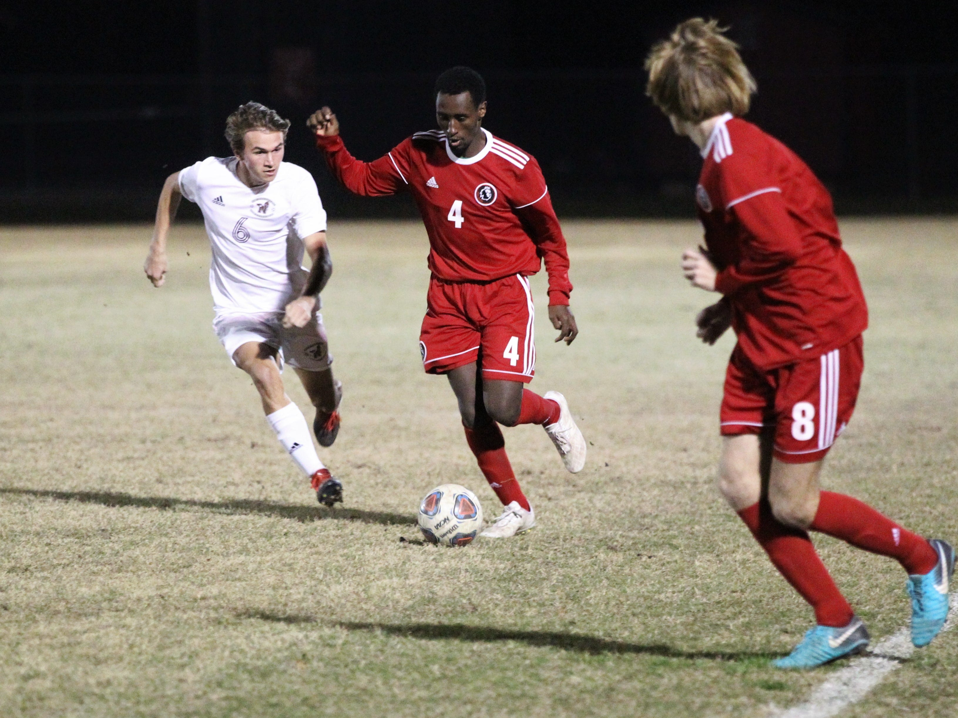 Leon's Ky Peltier looks for a pass as the Lions' boys soccer team beat Niceville 1-0 in a Region 1-4A semifinal on Feb. 9, 2019.