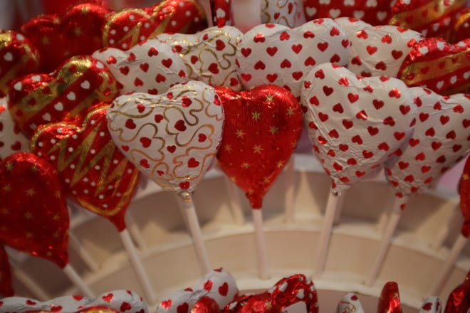 Heart-shaped chocolate lollipops are are one of the Valentine's Day speciality items for sale at Peterbrooke Chocolatier in Tallahassee.