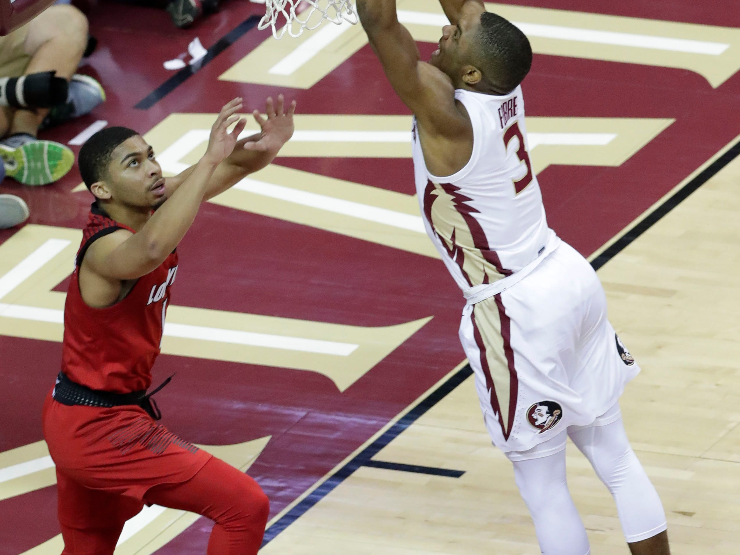Florida State Seminoles guard Trent Forrest (3) slam dunks as the Florida State Seminoles host the Louisville Cardinals at the Tucker Civic Center, Saturday Feb. 9, 2019.