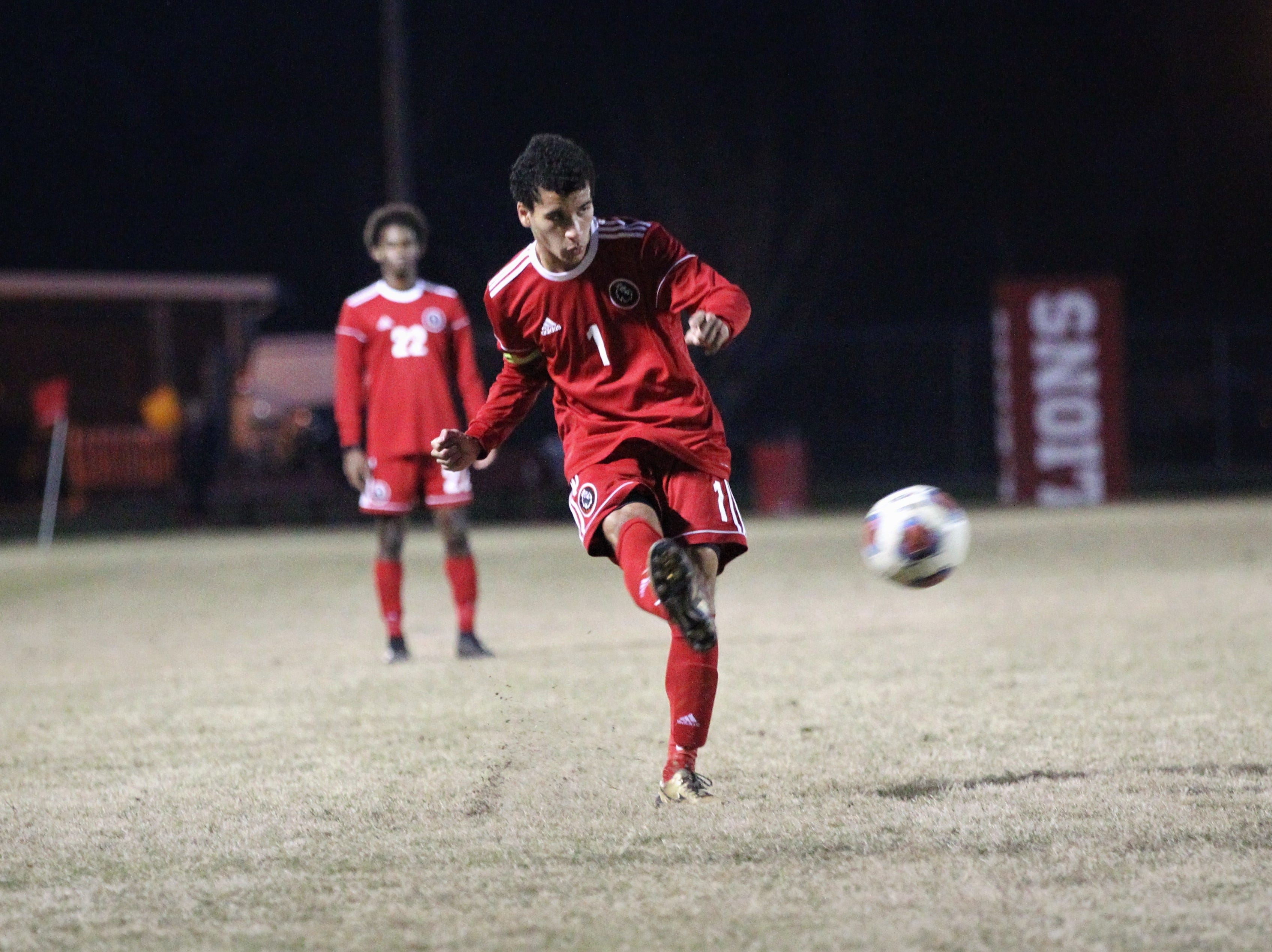 Leon's Sy Fontenot sends a cross into the box as the Lions' boys soccer team beat Niceville 1-0 in a Region 1-4A semifinal on Feb. 9, 2019.