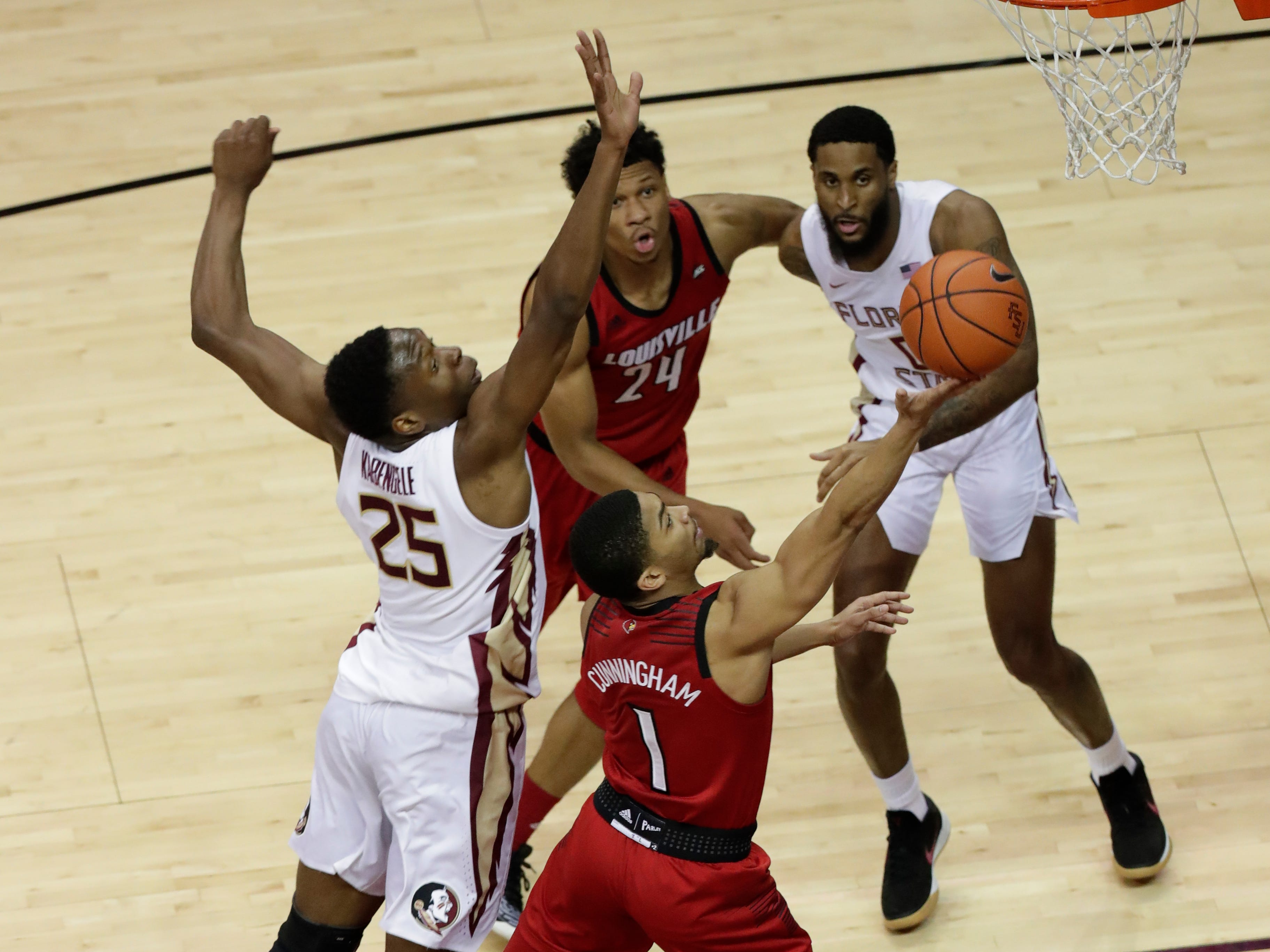 Louisville Cardinals guard Christen Cunningham (1) shoots from inside the paint with Florida State Seminoles forward Mfiondu Kabengele (25) coming from behind trying to block the shot. The Florida State Seminoles host the Louisville Cardinals at the Tucker Civic Center, Saturday Feb. 9, 2019.