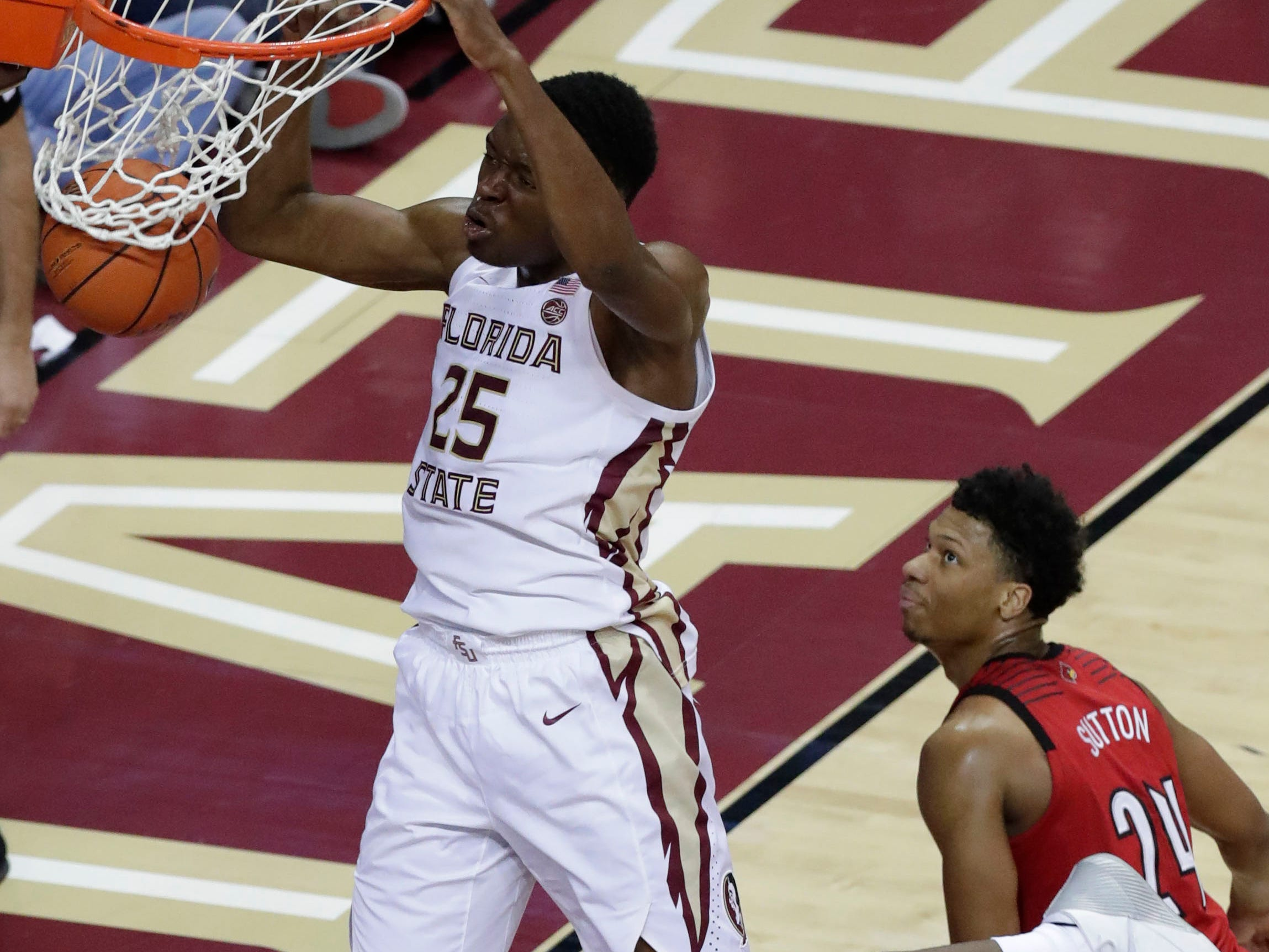 Florida State Seminoles forward Mfiondu Kabengele (25) slam dunks as the Florida State Seminoles host the Louisville Cardinals at the Tucker Civic Center, Saturday Feb. 9, 2019.