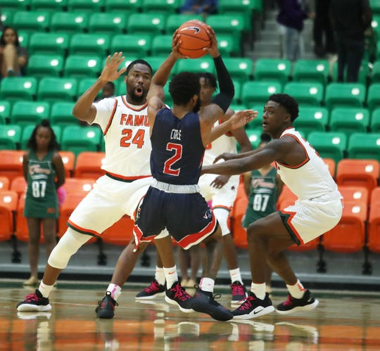 FAMU defense double teams R.J. Cole of Howard. The Rattlers lost to the Bison 70-66 on Saturday, Feb. 9 at the Lawson Center.