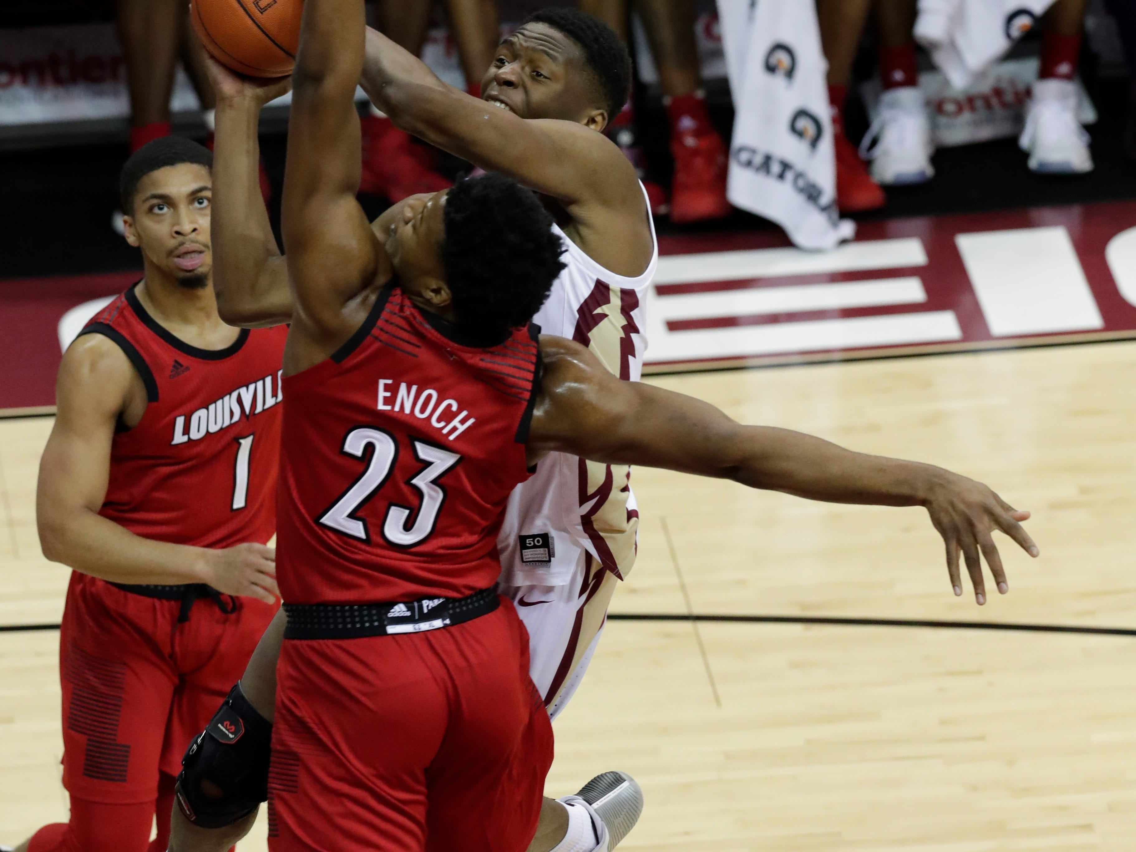 Florida State Seminoles forward Mfiondu Kabengele (25) drives in a layup with Louisville Cardinals center Steven Enoch (23) blocking his shot. The Florida State Seminoles host the Louisville Cardinals at the Tucker Civic Center, Saturday Feb. 9, 2019.