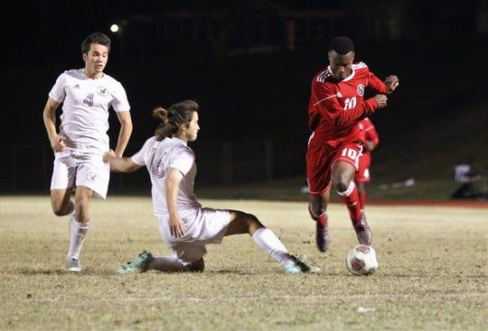 Leon's Jaden Jones-Riley evades a defender as the Lions' boys soccer team beat Niceville 1-0 in a Region 1-4A semifinal on Feb. 9, 2019.