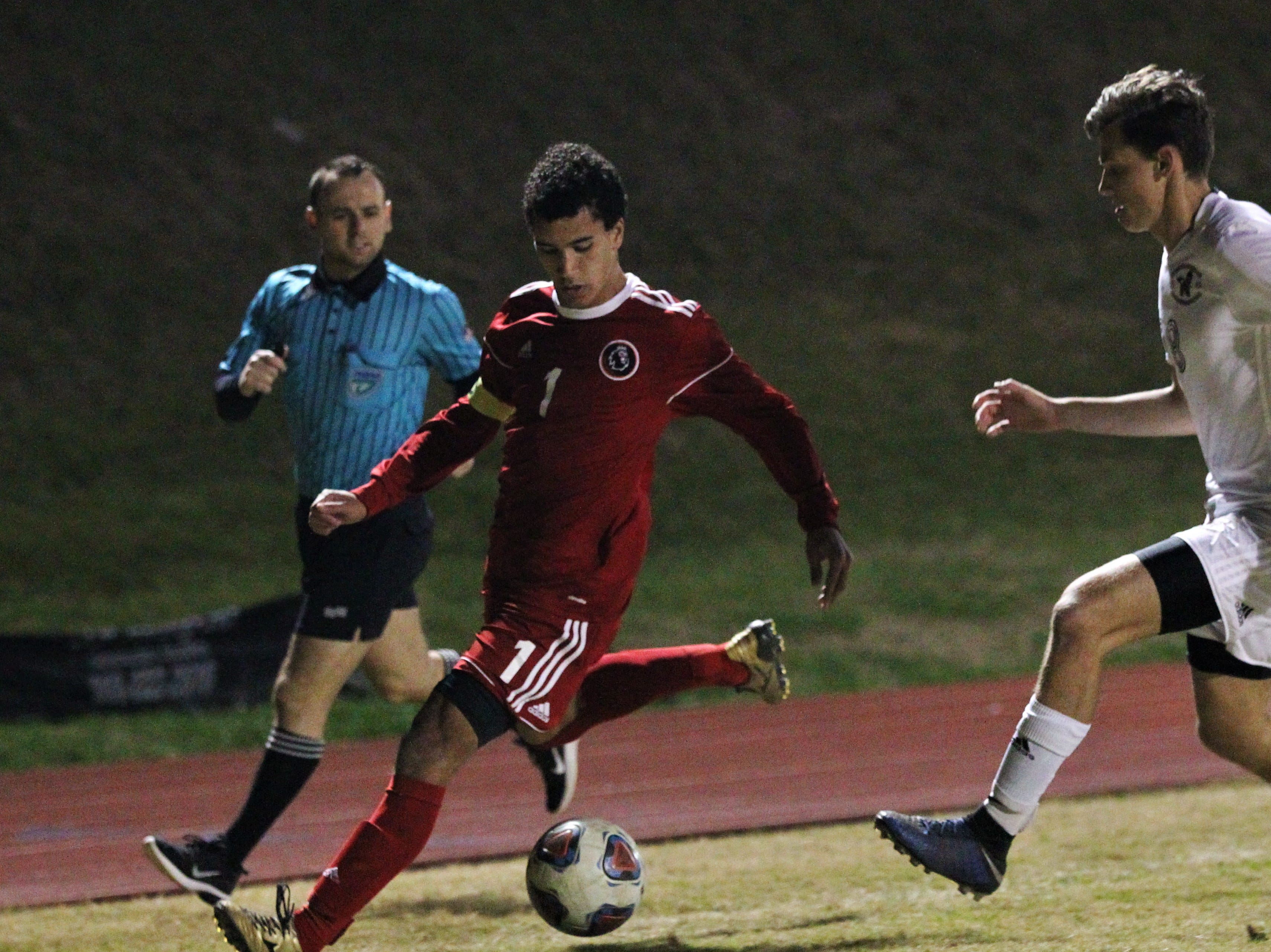 Leon's Sy Fontenot races down the line as the Lions' boys soccer team beat Niceville 1-0 in a Region 1-4A semifinal on Feb. 9, 2019.