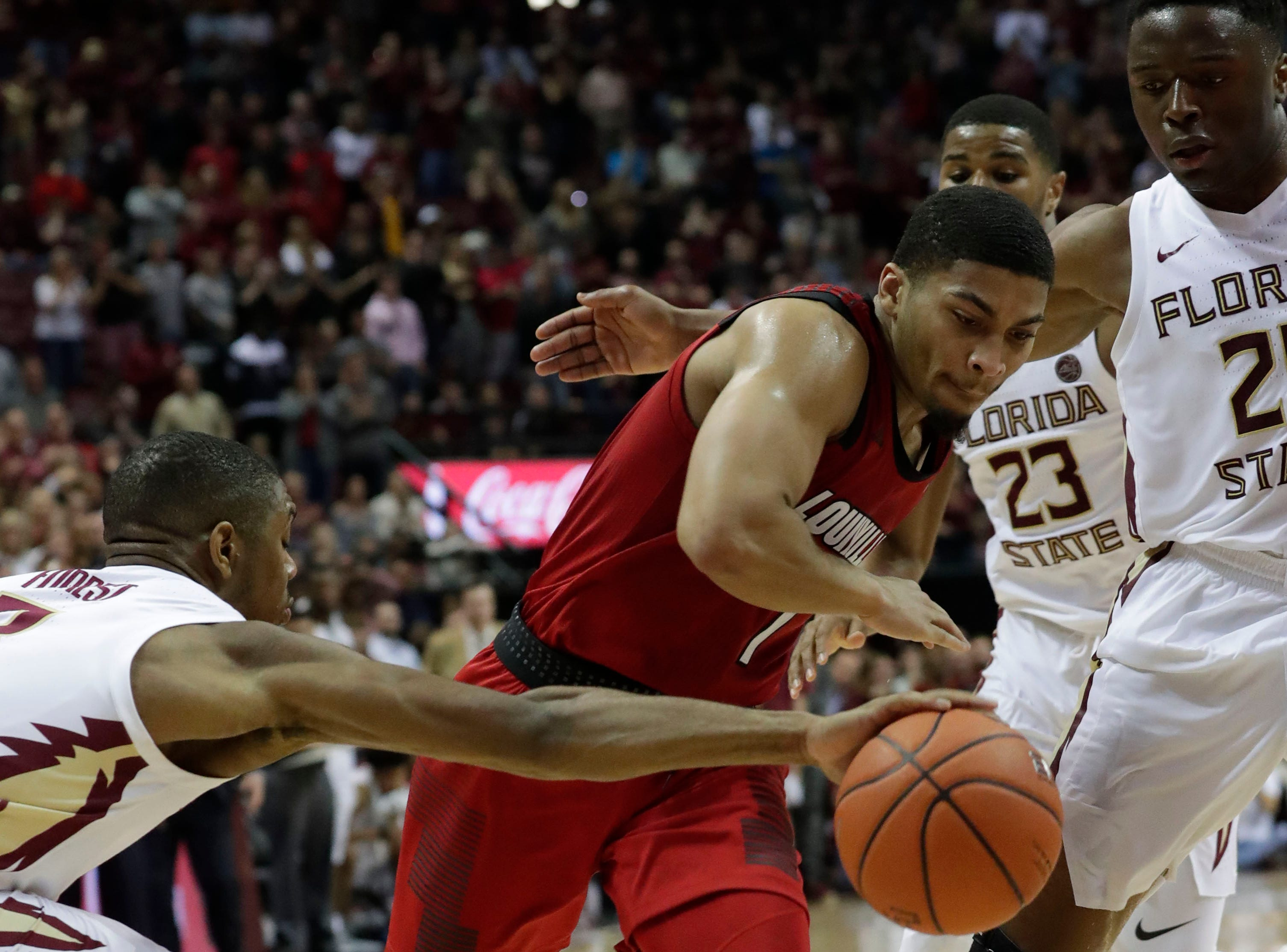 Florida State Seminoles guard Trent Forrest (3) steals the ball from Louisville Cardinals guard Christen Cunningham (1) as the Florida State Seminoles host the Louisville Cardinals at the Tucker Civic Center, Saturday Feb. 9, 2019.