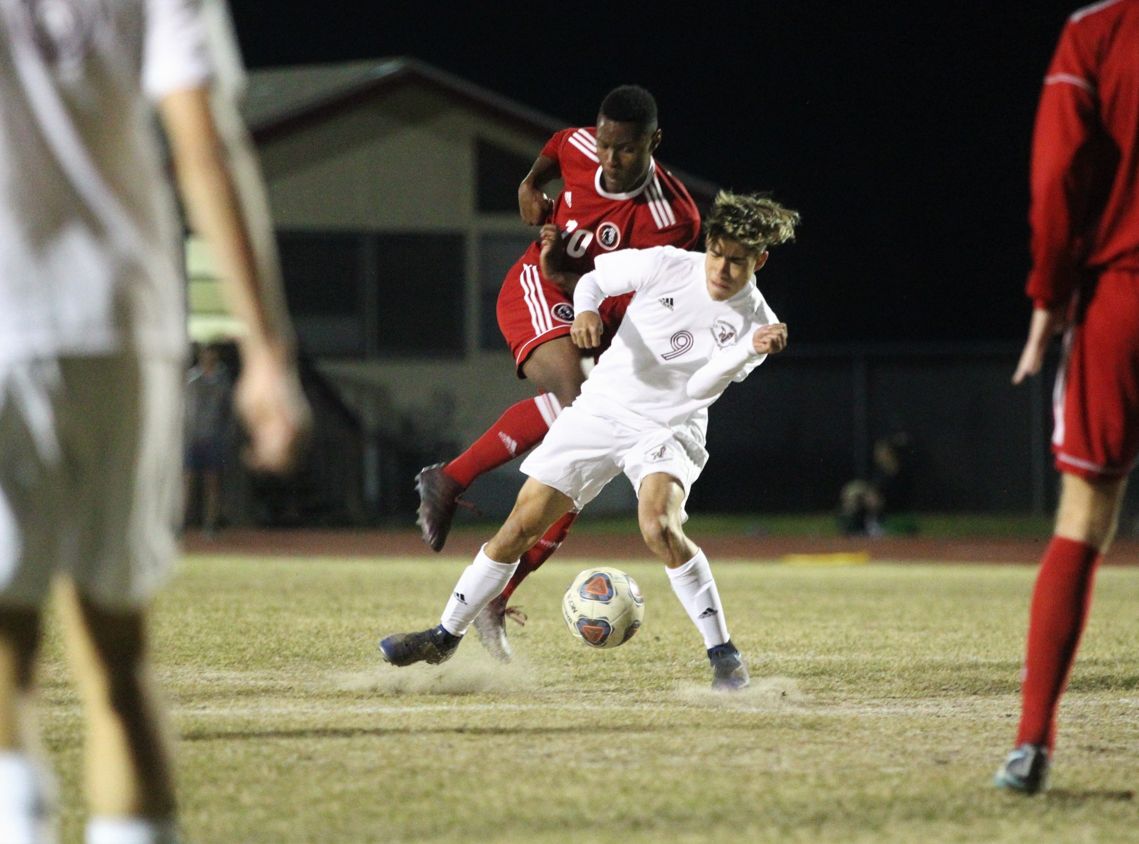Leon's Jaden Jones-Riley fights for possession as the Lions' boys soccer team beat Niceville 1-0 in a Region 1-4A semifinal on Feb. 9, 2019.