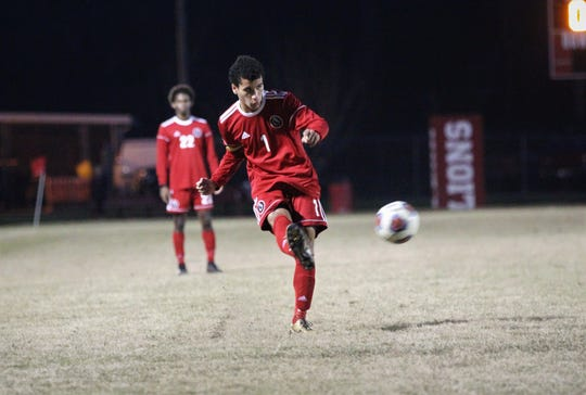 Leon's Sy Fontenot takes a cross as the Lions' boys soccer team beat Niceville 1-0 in a Region 1-4A semifinal on Feb. 9, 2019.