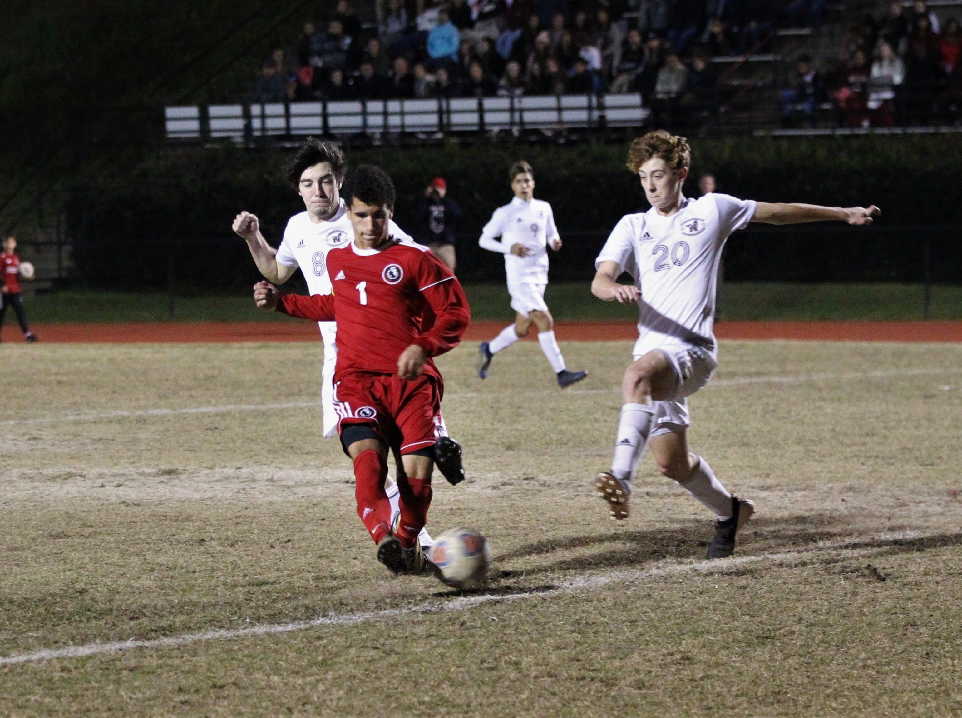 Leon's Sy Fontenot tries to one-time a pass for a goal as the Lions' boys soccer team beat Niceville 1-0 in a Region 1-4A semifinal on Feb. 9, 2019.