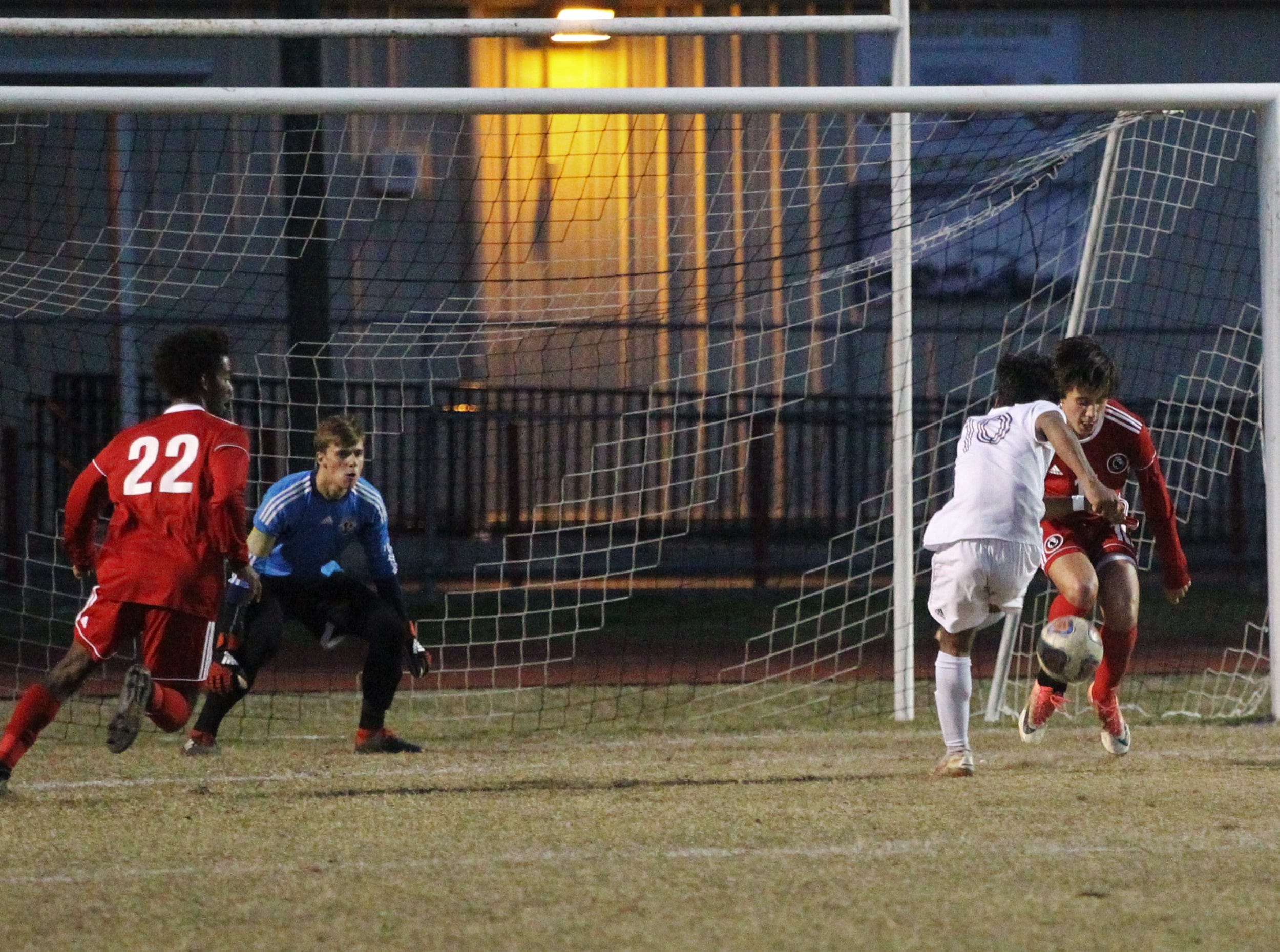 Leon's Patrick Campo saves a shot on goal as the Lions' boys soccer team beat Niceville 1-0 in a Region 1-4A semifinal on Feb. 9, 2019.