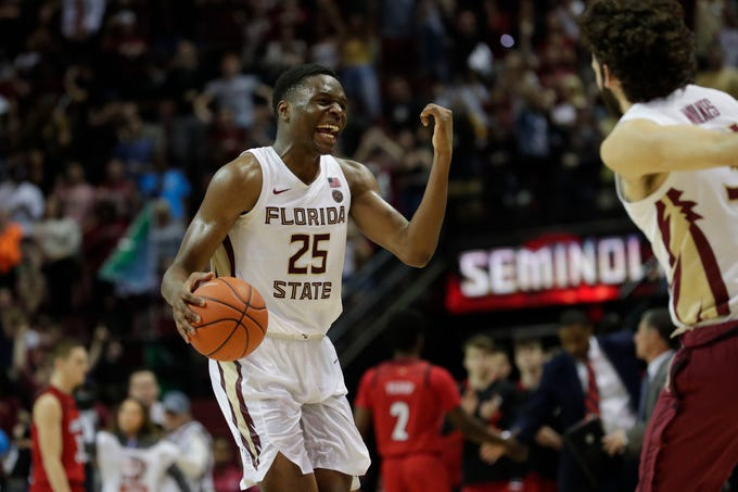 Florida State Seminoles forward Mfiondu Kabengele (25) celebrates the team's win against the Louisville Cardinals after going into overtime at the Tucker Civic Center, Saturday Feb. 9, 2019.