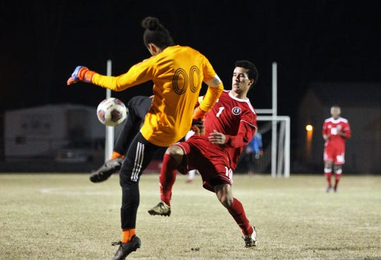 Leon's Sy Fontenot tries to pressure Niceville's keeper into a mistake as the Lions' boys soccer team beat Niceville 1-0 in a Region 1-4A semifinal on Feb. 9, 2019.