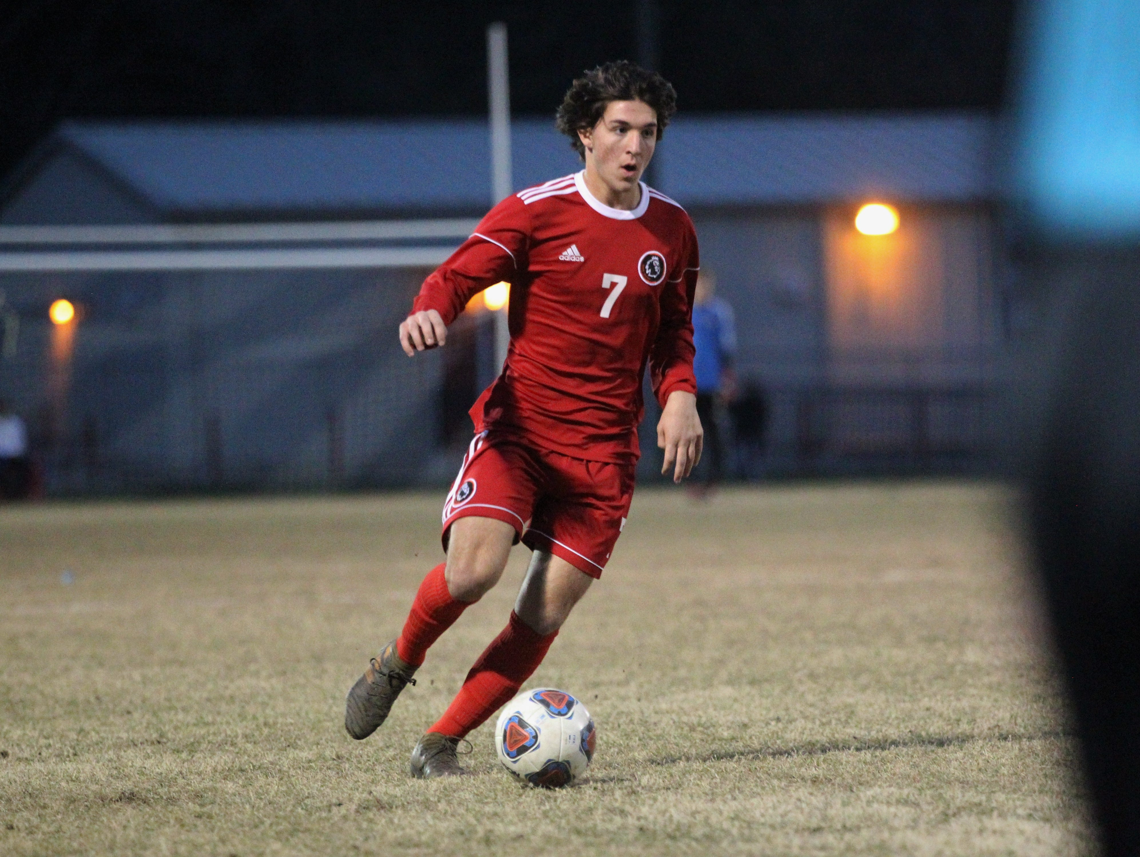 Leon's Henry Regalado dribbles upfield as the Lions' boys soccer team beat Niceville 1-0 in a Region 1-4A semifinal on Feb. 9, 2019.