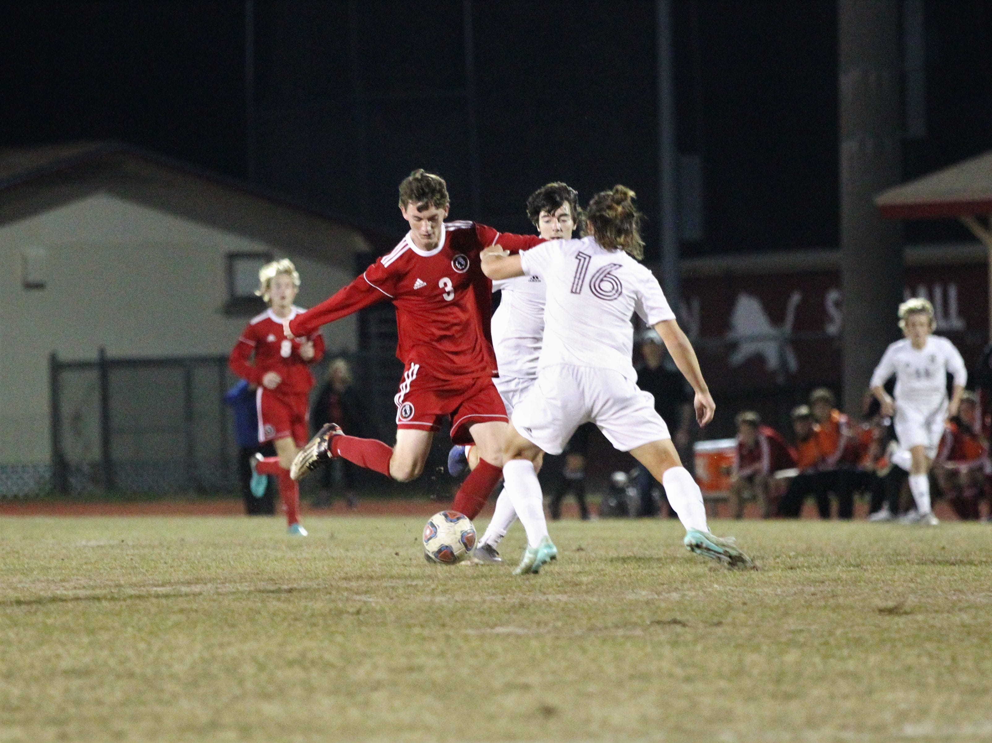Leon's Tanner Powell passes ahead as the Lions' boys soccer team beat Niceville 1-0 in a Region 1-4A semifinal on Feb. 9, 2019.
