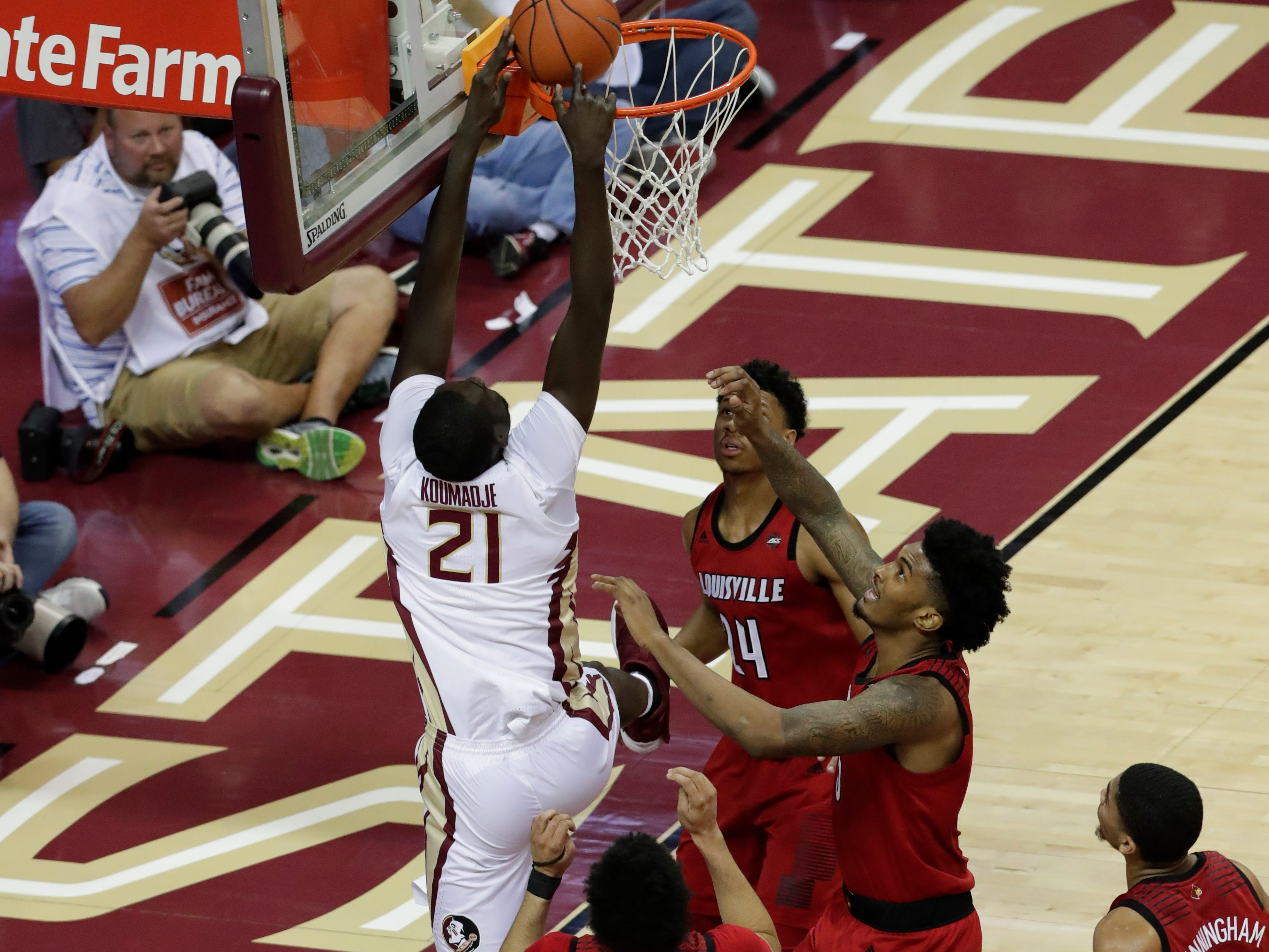 Florida State Seminoles center Christ Koumadje (21) shots from inside the paint with defenders surrounding him as the Florida State Seminoles host the Louisville Cardinals at the Tucker Civic Center, Saturday Feb. 9, 2019.