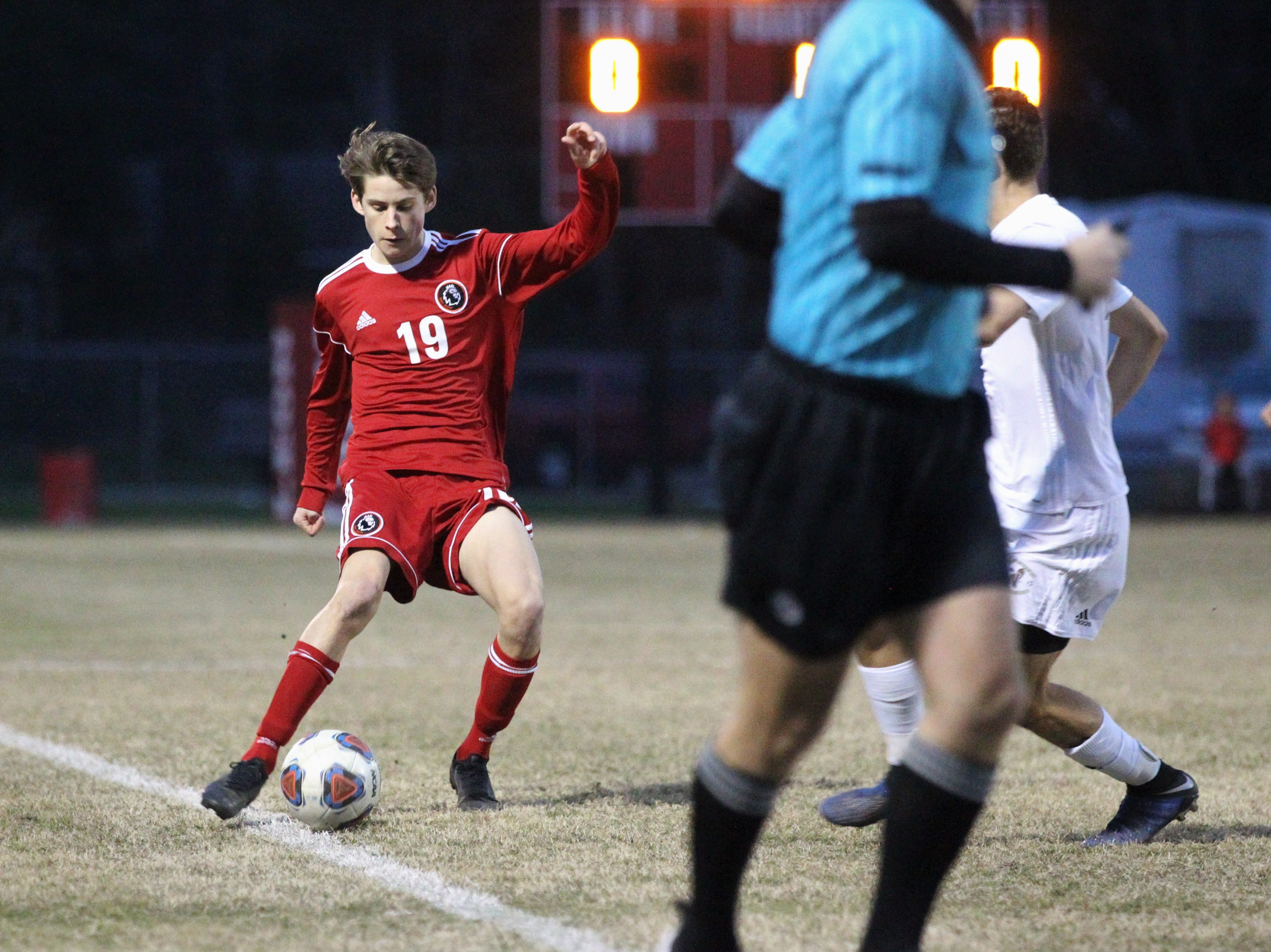 Leon's Antonio Nunez dribbles on the sideline as the Lions' boys soccer team beat Niceville 1-0 in a Region 1-4A semifinal on Feb. 9, 2019.