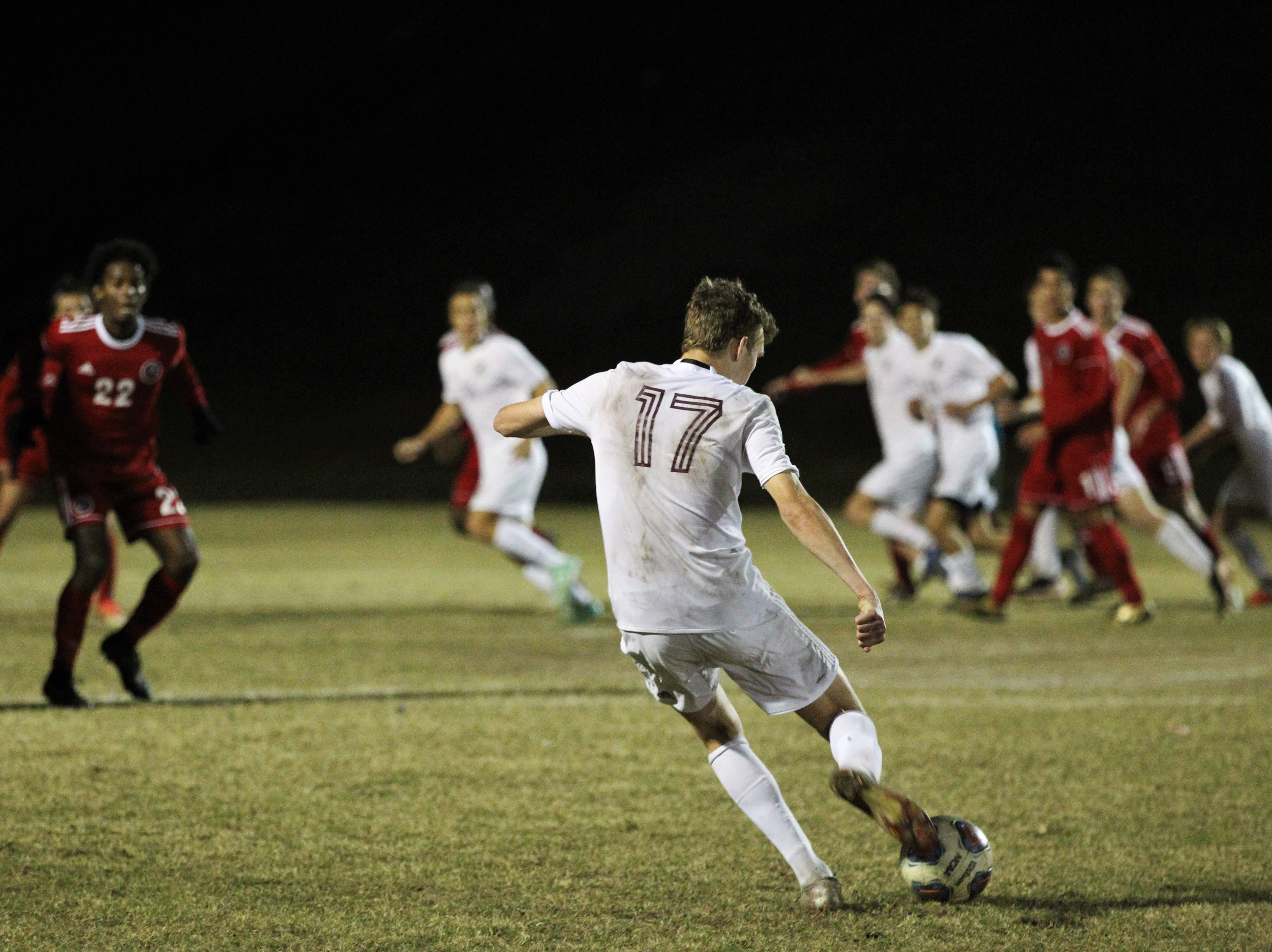 Niceville's Logan Harrelson takes a last-second free kick as Leon's boys soccer team beat Niceville 1-0 in a Region 1-4A semifinal on Feb. 9, 2019.