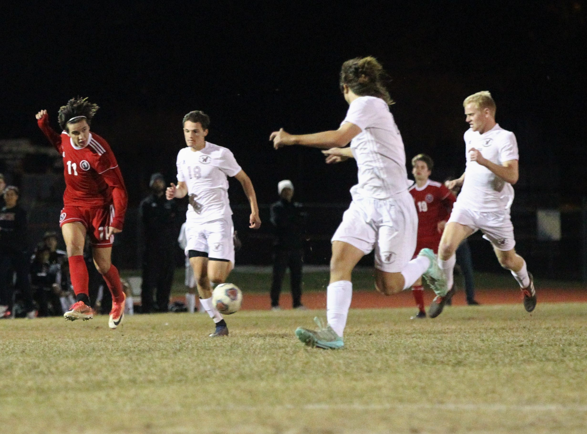 Leon's Patrick Campo passes ahead as the Lions' boys soccer team beat Niceville 1-0 in a Region 1-4A semifinal on Feb. 9, 2019.