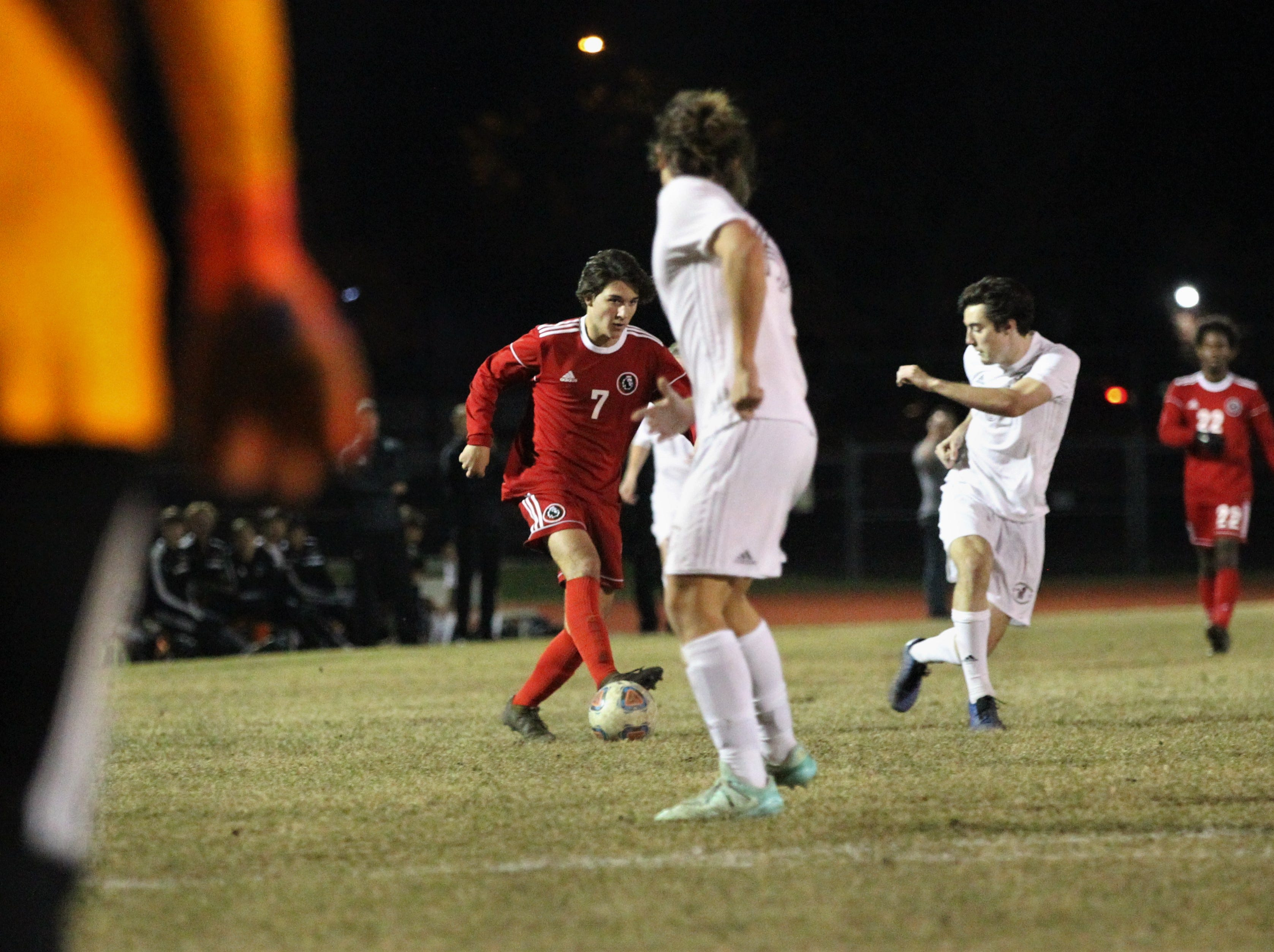 Leon's Henry Regalado dribbles into the attacking third as the Lions' boys soccer team beat Niceville 1-0 in a Region 1-4A semifinal on Feb. 9, 2019.