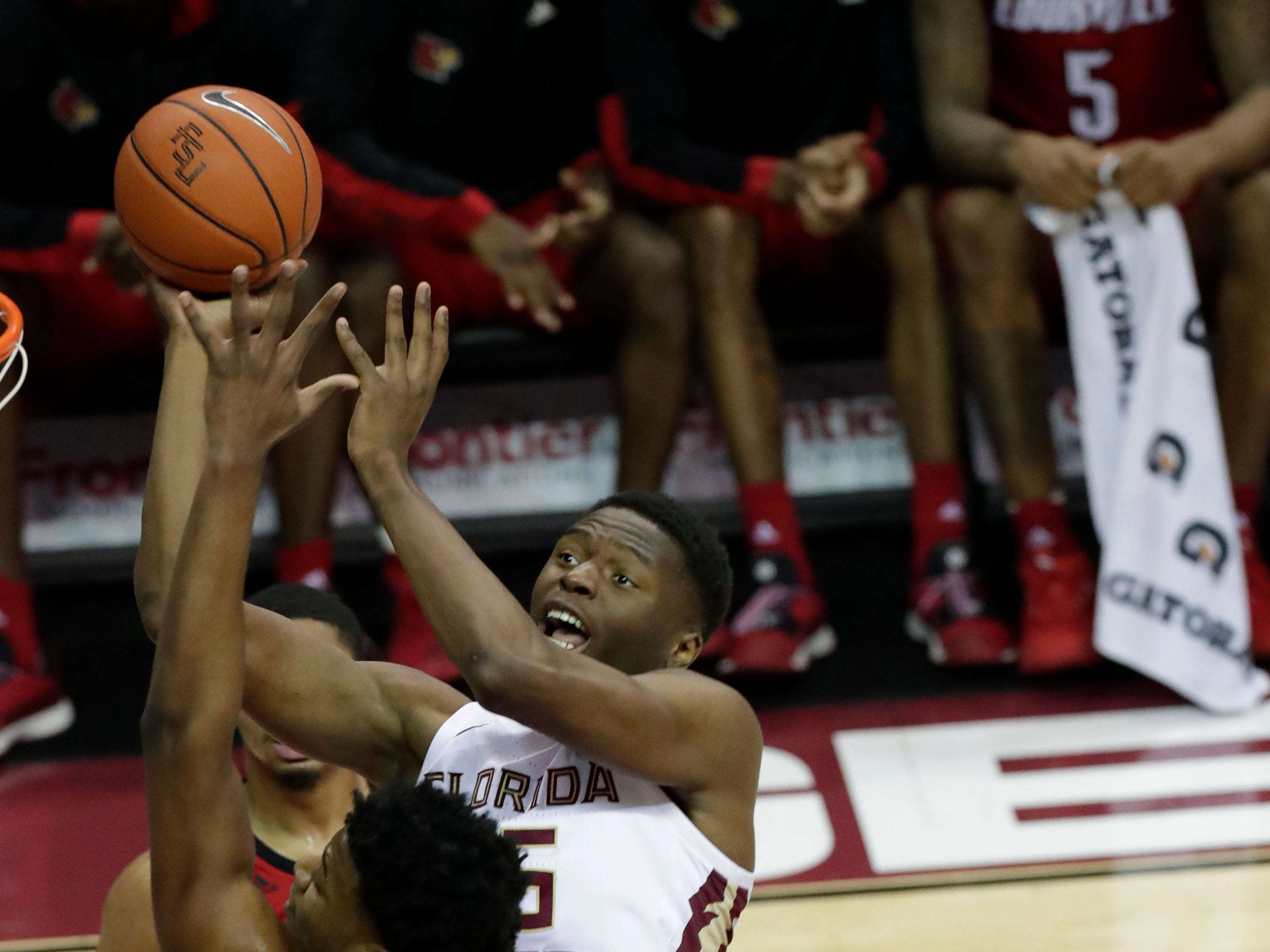 Florida State Seminoles forward Mfiondu Kabengele (25) shoots from inside the paint with Louisville Cardinals center Steven Enoch (23) going up to block the shot. The Florida State Seminoles host the Louisville Cardinals at the Tucker Civic Center, Saturday Feb. 9, 2019.