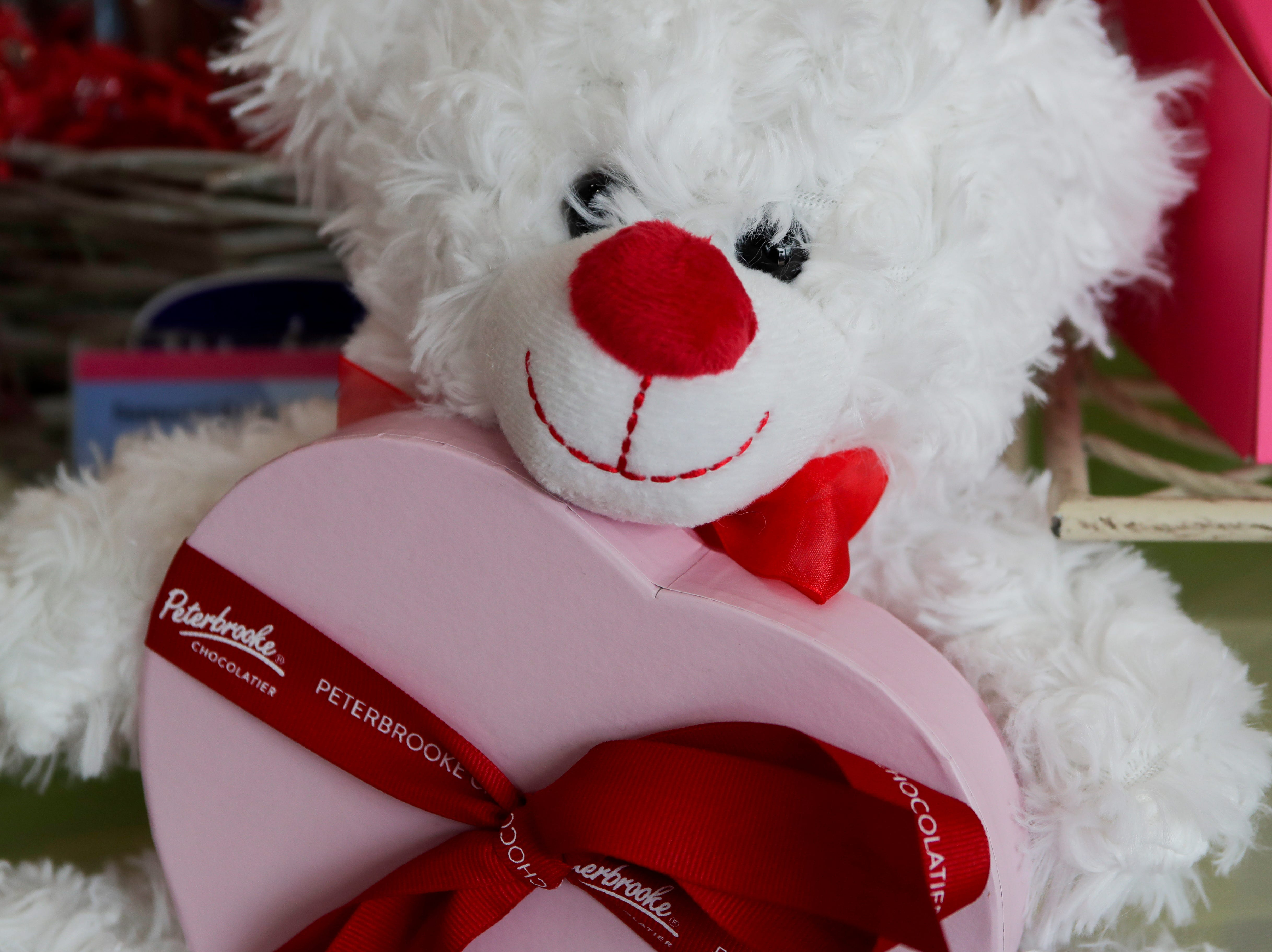 A heart-shaped box of assorted chocolates and a teddy bear is a popular gift purchase for Peterbrooke Chocolatier customers on Valentines Day.