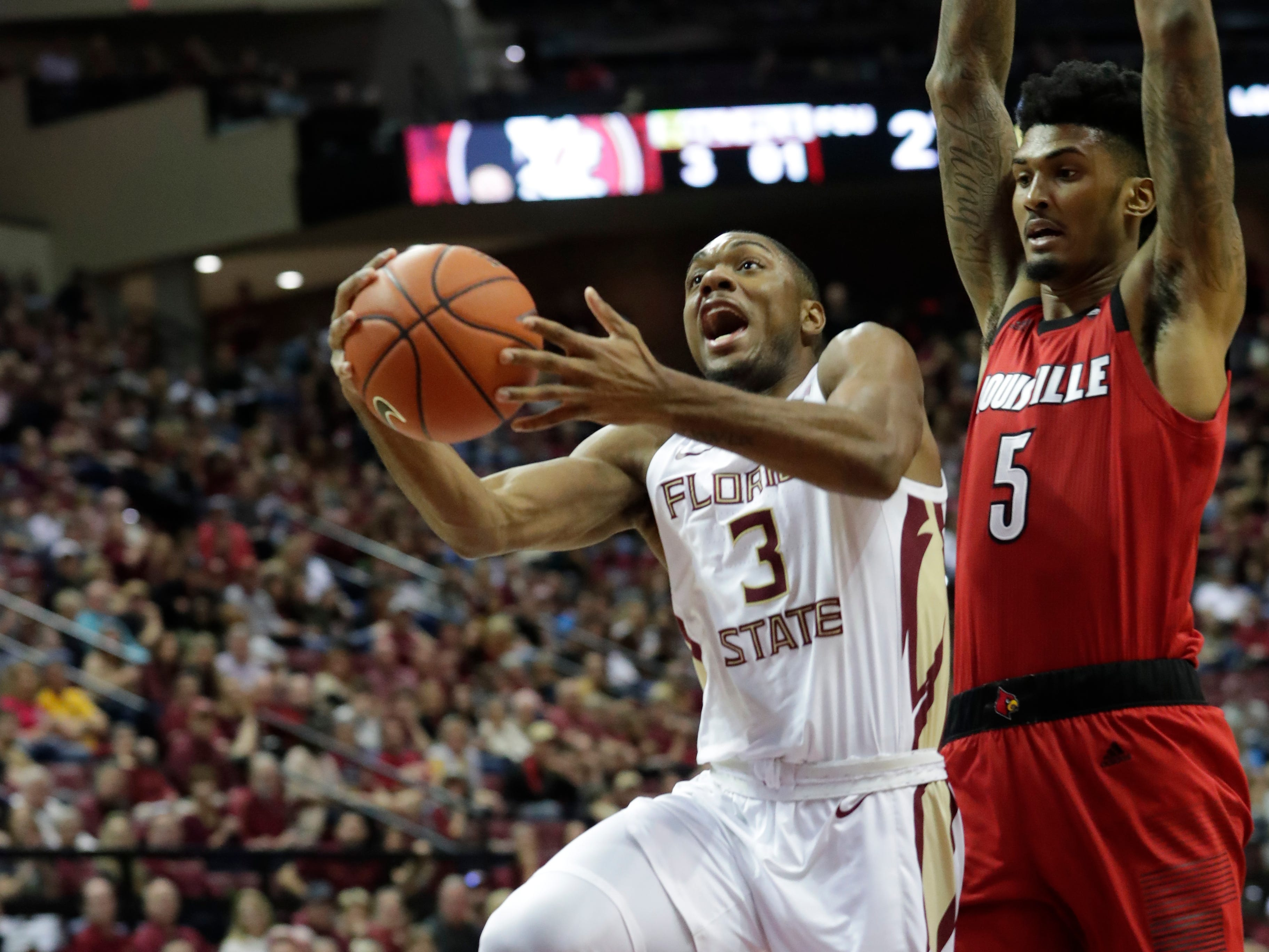 Florida State Seminoles guard Trent Forrest (3) drives in a layup past Louisville Cardinals center Malik Williams (5) as the Florida State Seminoles host the Louisville Cardinals at the Tucker Civic Center, Saturday Feb. 9, 2019.